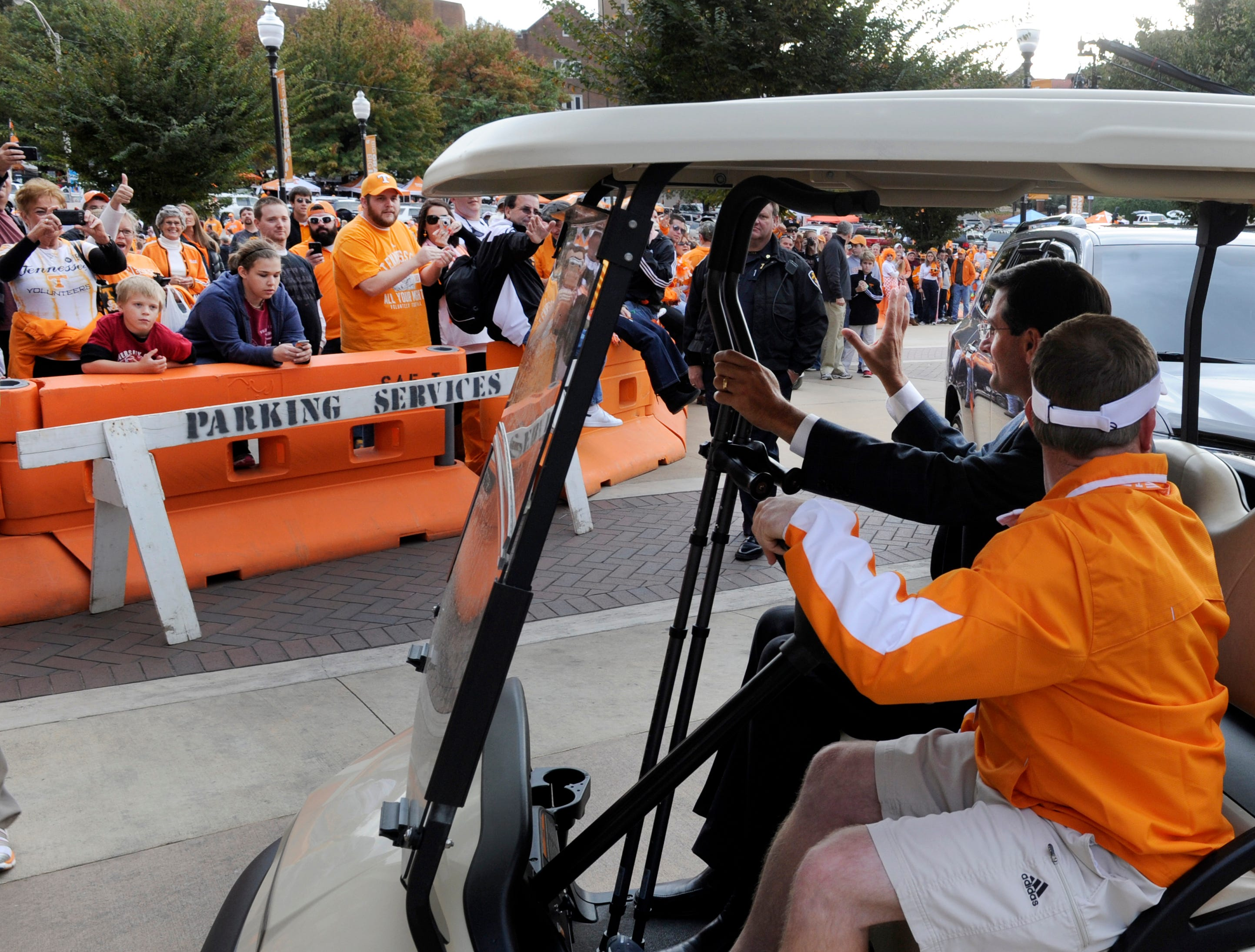 Tennessee head coach Derek Dooley waves to fans as he is driven into Neyland Stadium on a cart Saturday, Oct. 20, 2012 in Knoxville.