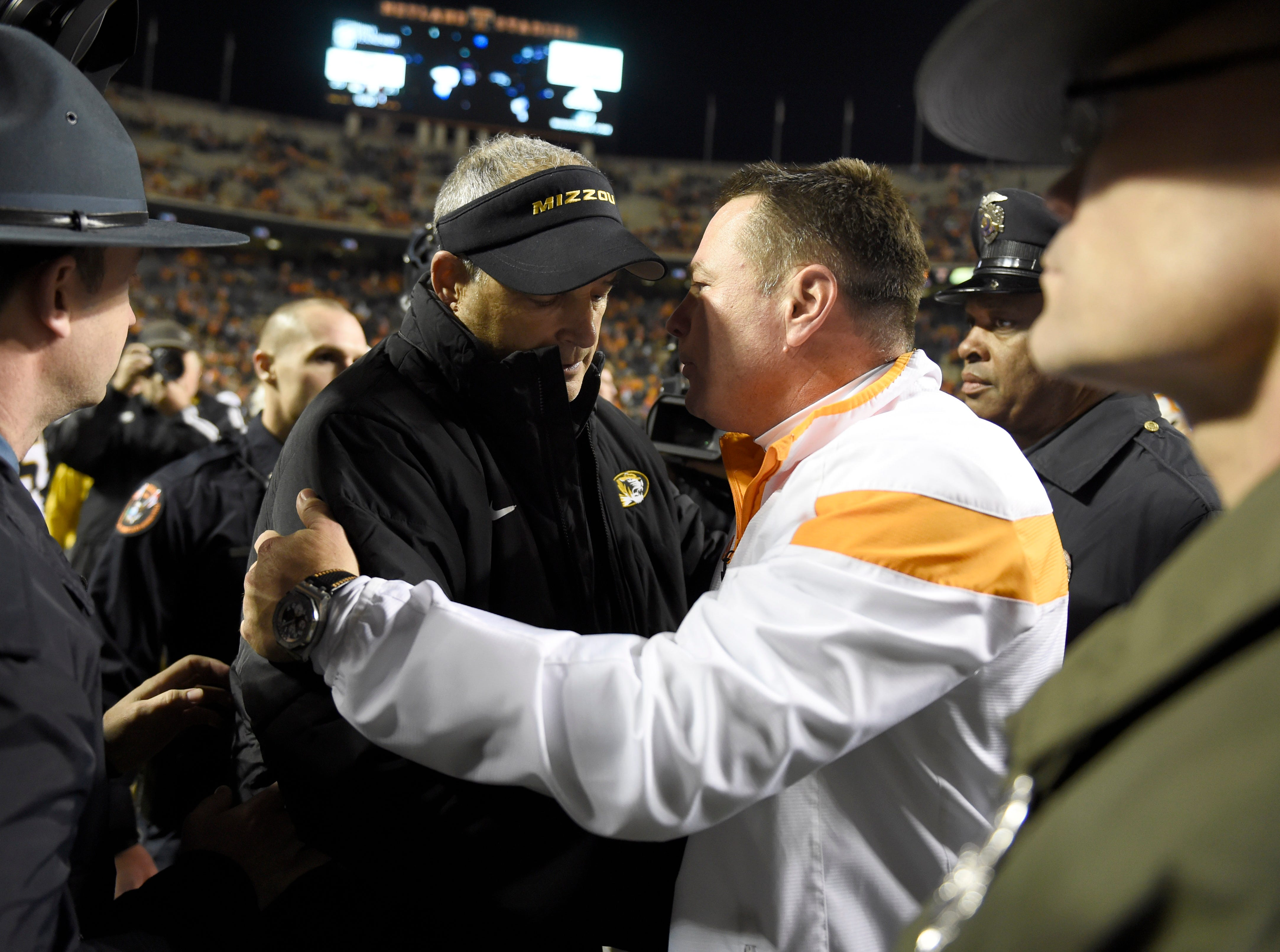 Missouri head coach Gary Pinkel greets Tennessee coach Butch Jones after their college football game at Neyland Stadium in Knoxville, Tenn., Saturday, Nov. 22, 2014.  Missouri won 29-21.