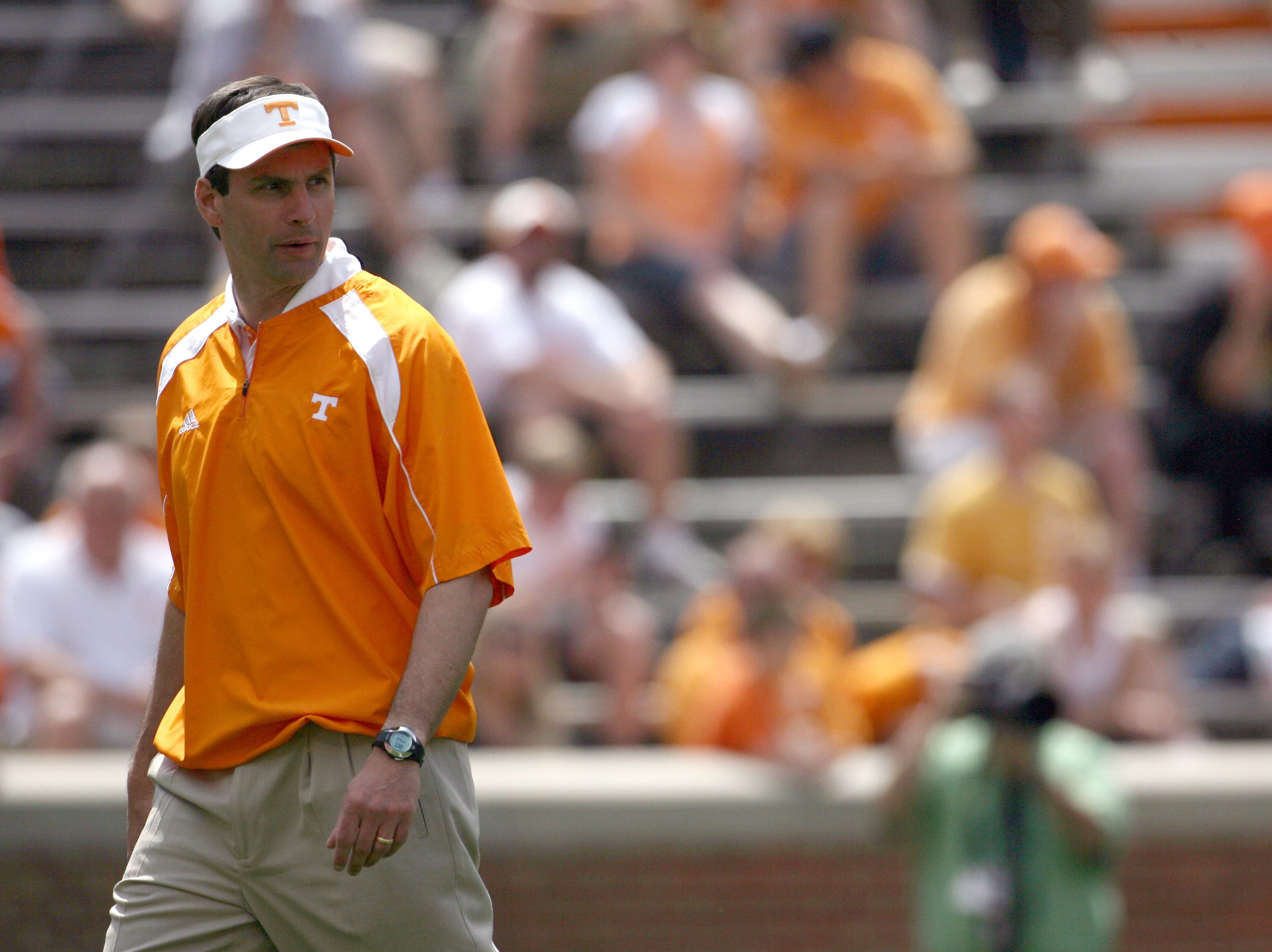 In this photo taken on Saturday, April 17, 2010, Tennessee head coach Derek Dooley watches the Vols play during the Orange and White spring college football game at Neyland Stadium in Knoxville, Tenn.