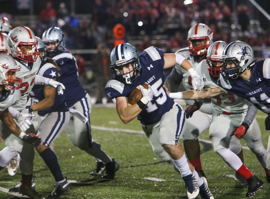 Farragut's Kyle Carter (15) takes advantage of an opening during the Farragut versus Ooltewah TSSAA play-off high school football game at Farragut high school in Knoxville Friday Nov. 9 2018.