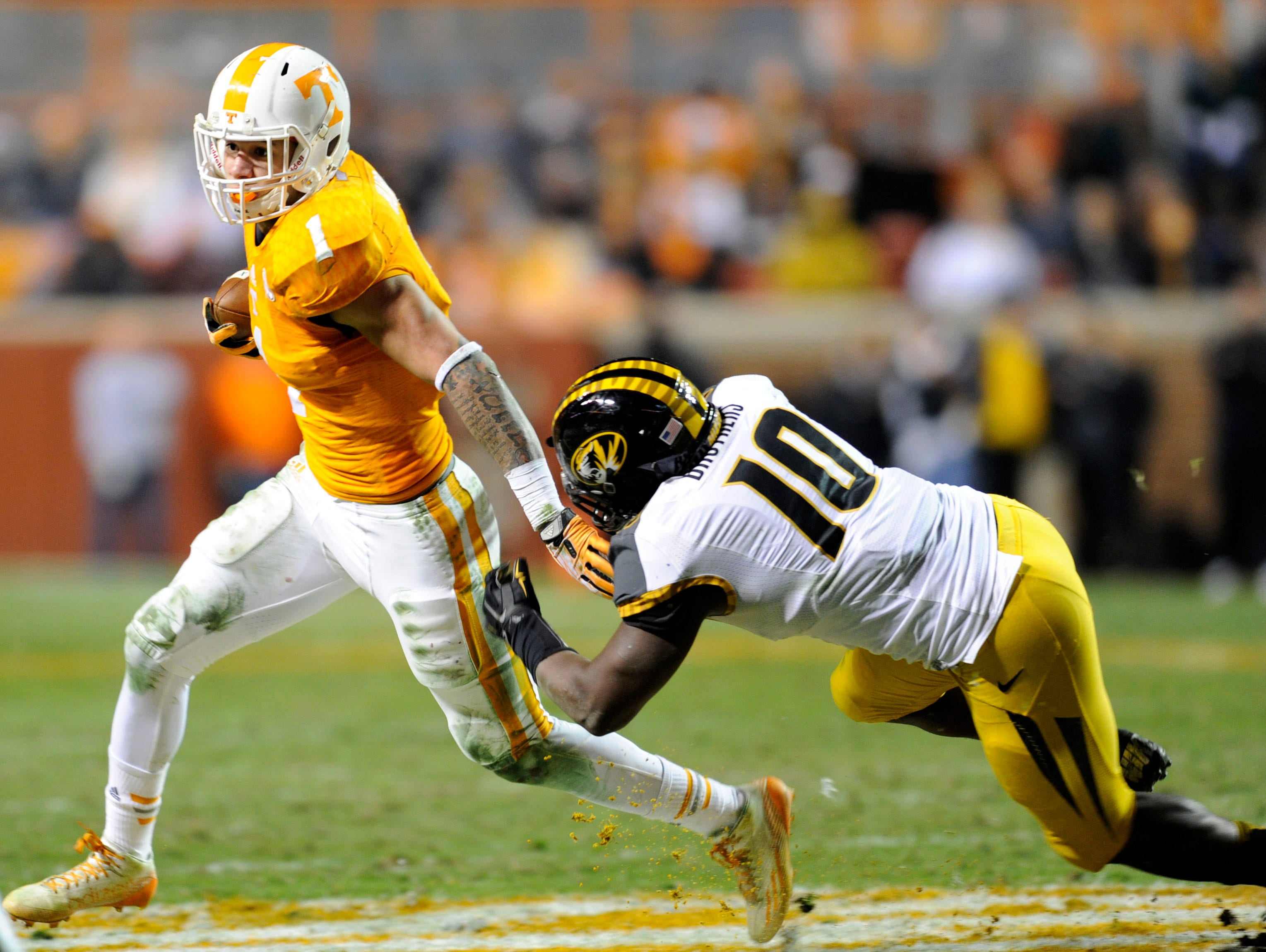 Missouri linebacker Kentrell Brothers (10) tries to stop Tennessee running back Jalen Hurd (1) during their college football game at Neyland Stadium, Saturday, Nov. 22, 2014 in Knoxville, TN.