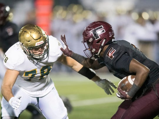 Fulton's DeShawn Page (6) comes up against Catholic's Cooper Mays (78). Knoxville Catholic beat Fulton, 28-25 in the second round of the Class 5A playoffs on Friday, November 9, 2018.