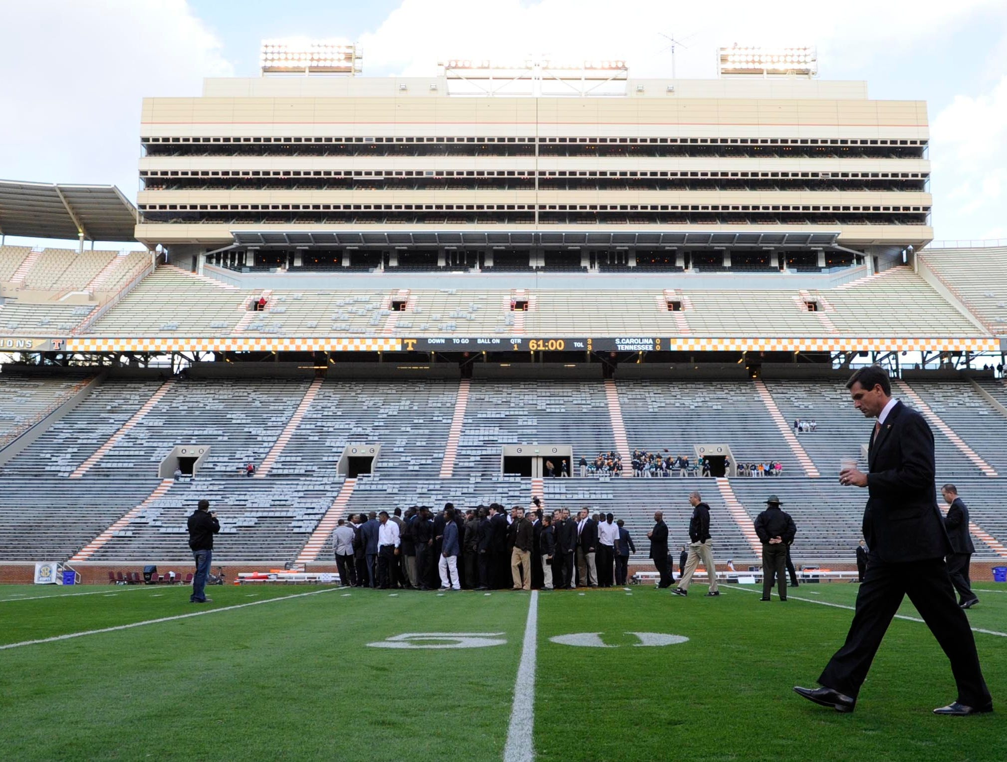 Tennessee head coach Derek Dooley, right, surveys the field before the game against South Carolina at Neyland Stadium on Saturday, Oct. 29, 2011.