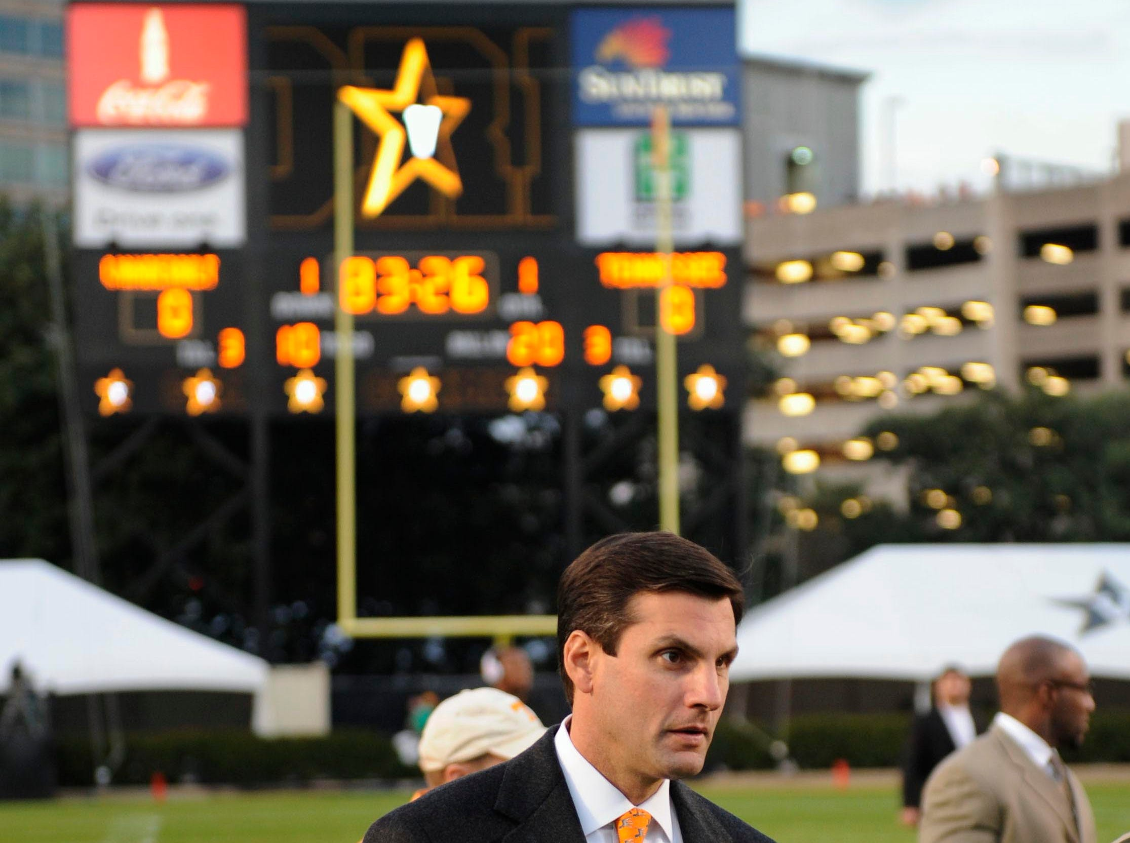 Tennessee head coach Derek Dooley walks across the field as he and the team arrived Saturday, Nov. 20, 2010 in Vanderbilt Stadium in Nashville.