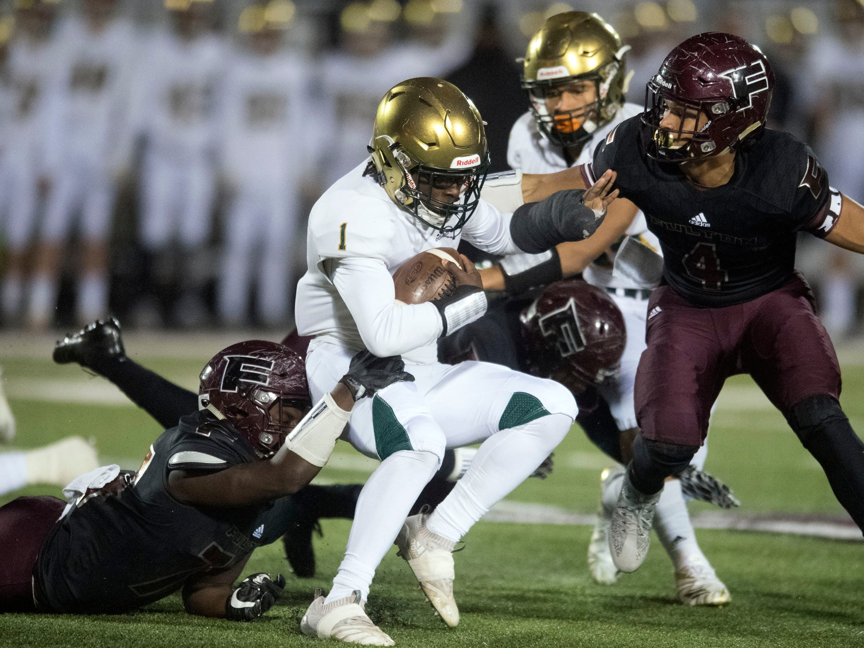 Knoxville Catholic's Keondre' Jarmon (1) is tacked by the Fulton defense. Knoxville Catholic beat Fulton, 28-25 in the second round of the Class 5A playoffs on Friday, November 9, 2018.
