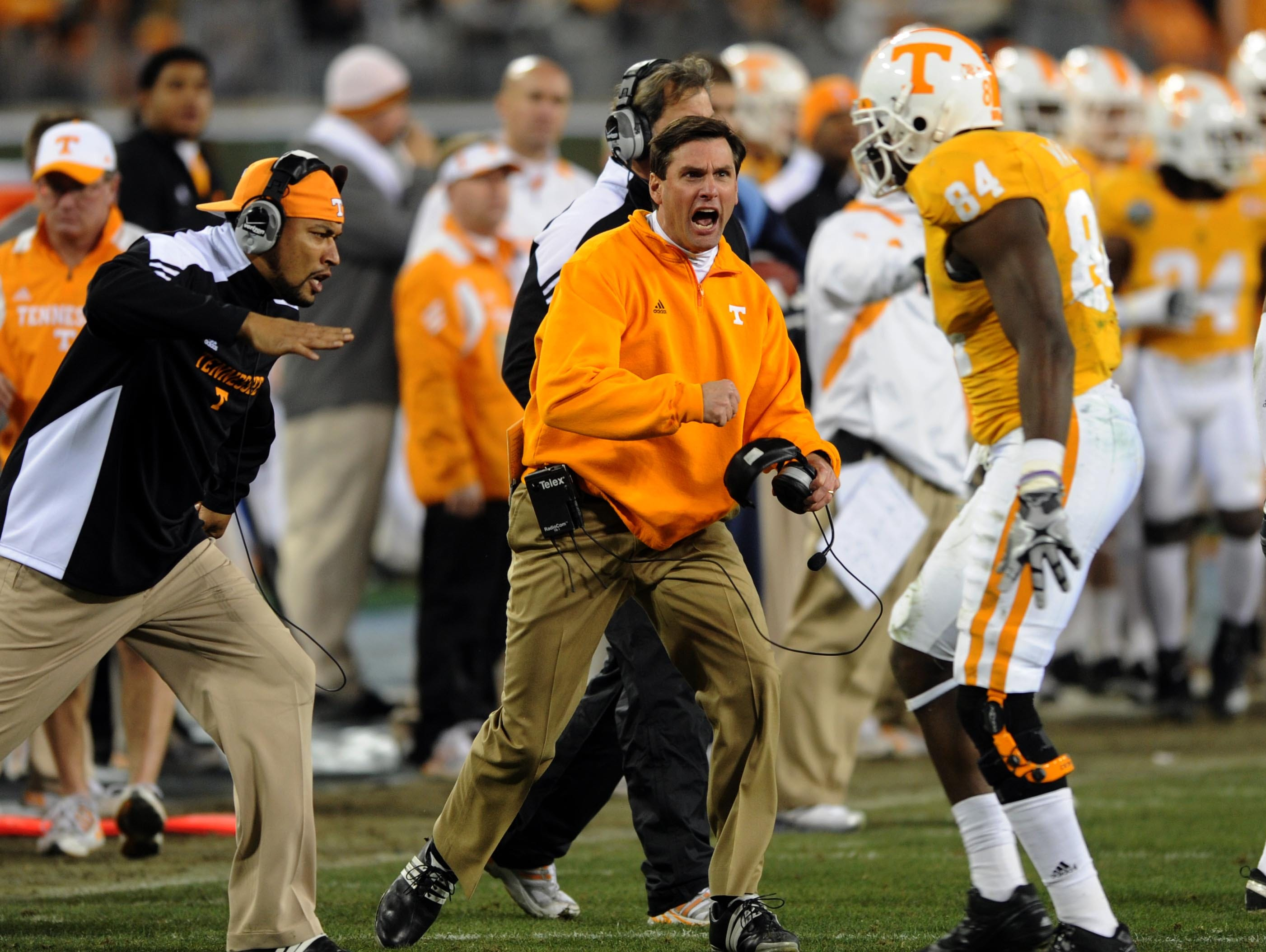Tennessee head coach Derek Dooley is excited about a good defensive attempt by Chris Walker (84) during the first half Thursday, Dec. 30, 2010 in the Music City Bowl in Nashville at LP Field.