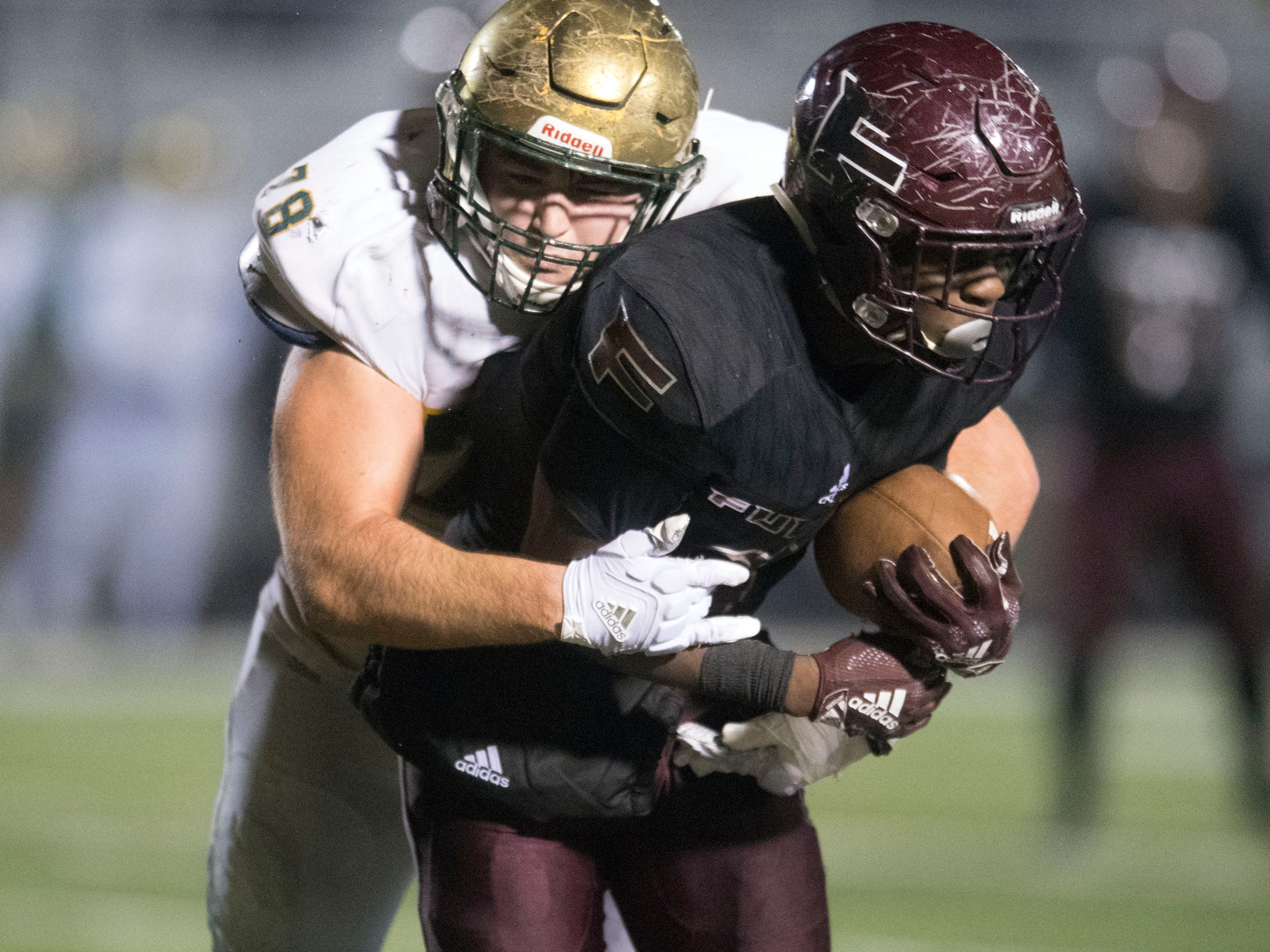 Fulton's DeShawn Page (6) is tackled by Knoxville Catholic's Cooper Mays (78). Knoxville Catholic beat Fulton, 28-25 in the second round of the Class 5A playoffs on Friday, November 9, 2018.