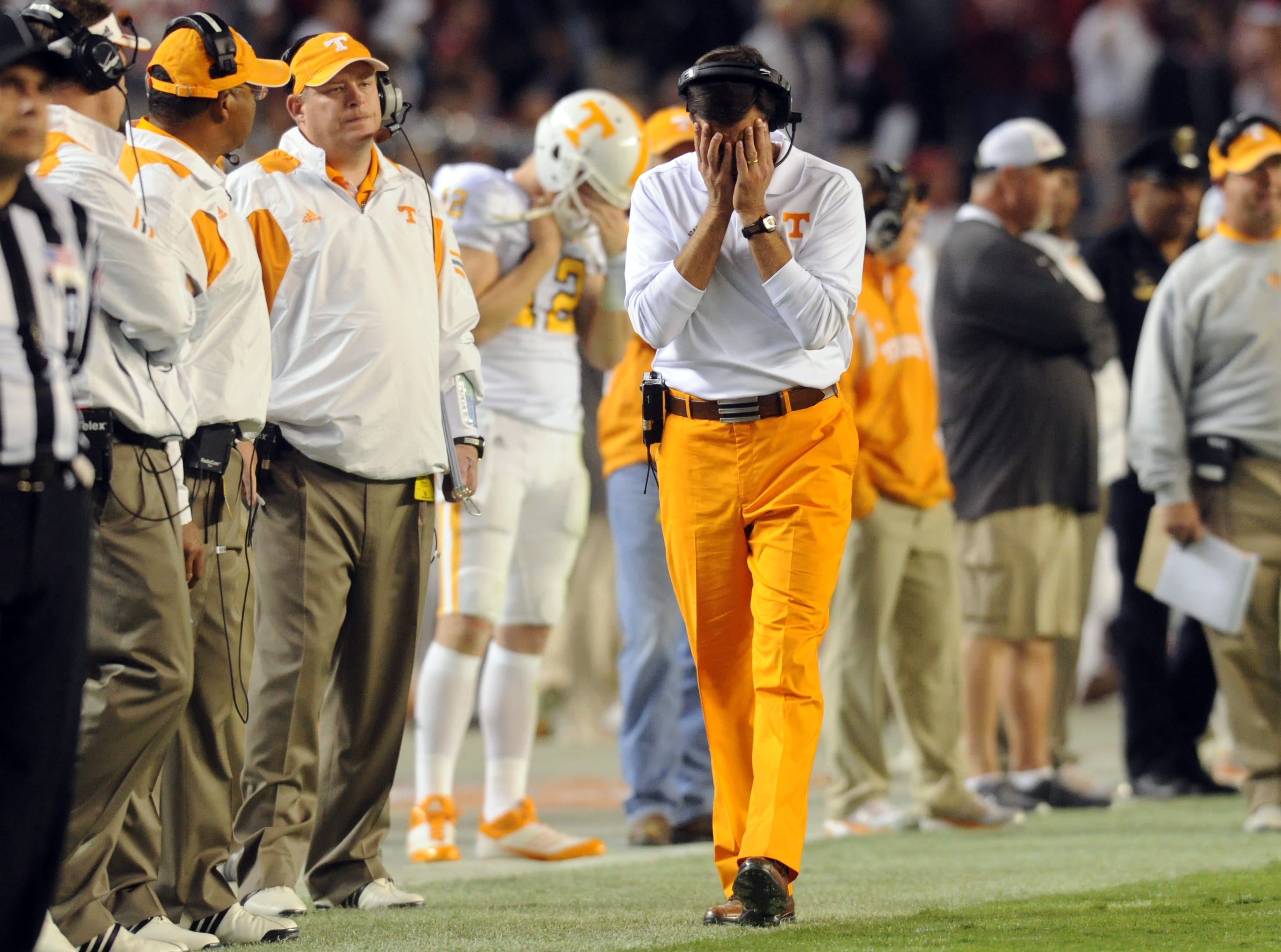 Tennessee head coach Derek Dooley walks the sideline with his head in his hands as Alabama closes out a 37-6 win during the fourth quarter at Bryant-Denny Stadium in Tuscaloosa, Ala., Saturday, Oct. 22, 2011.