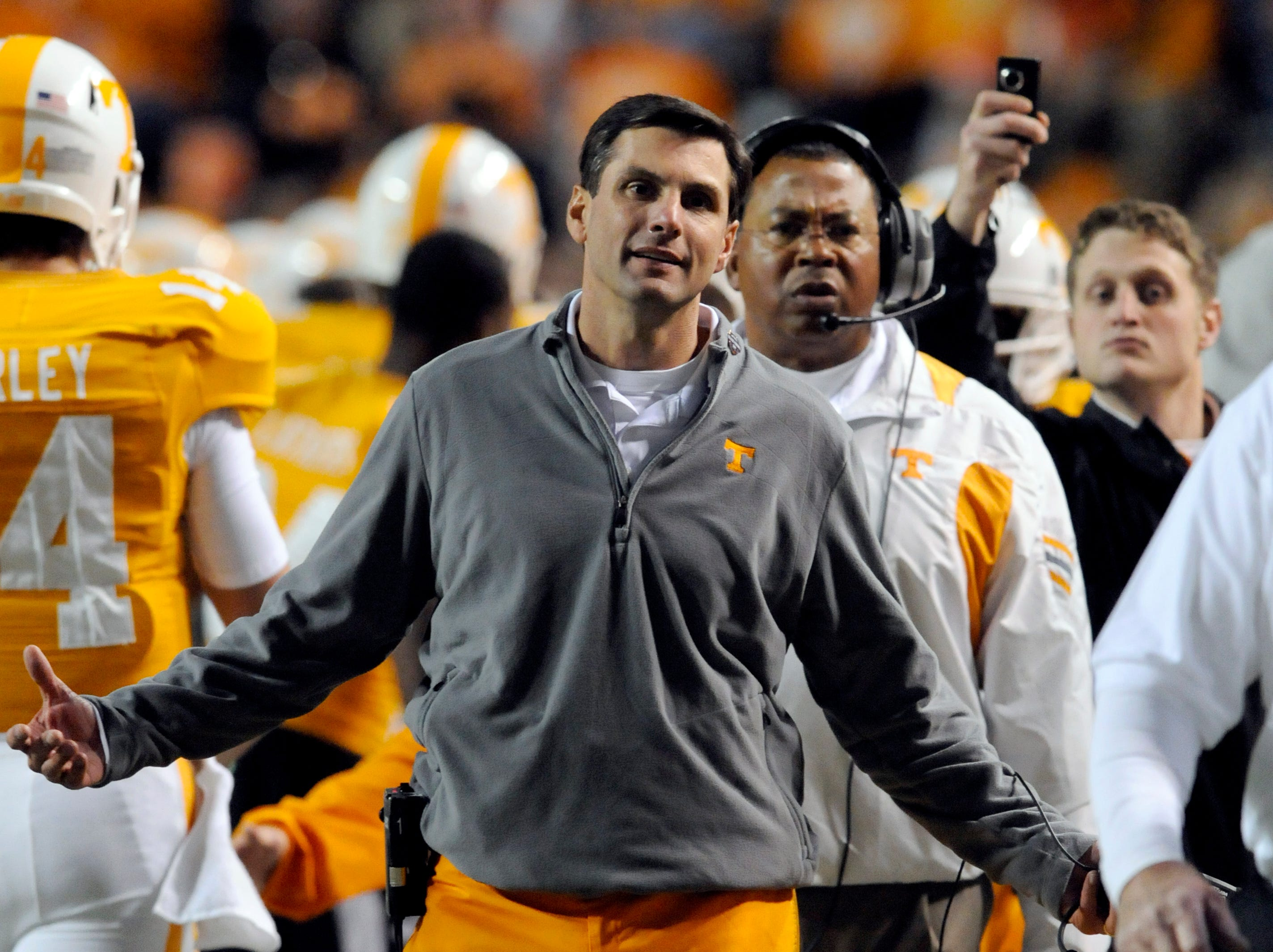 Tennessee head coach Derek Dooley gestures at wide receiver Da'Rick Rogers (21) after he got a penalty on a touchdown during the first half against MTSU Saturday, Nov. 5, 2011 in Neyland Stadium.
