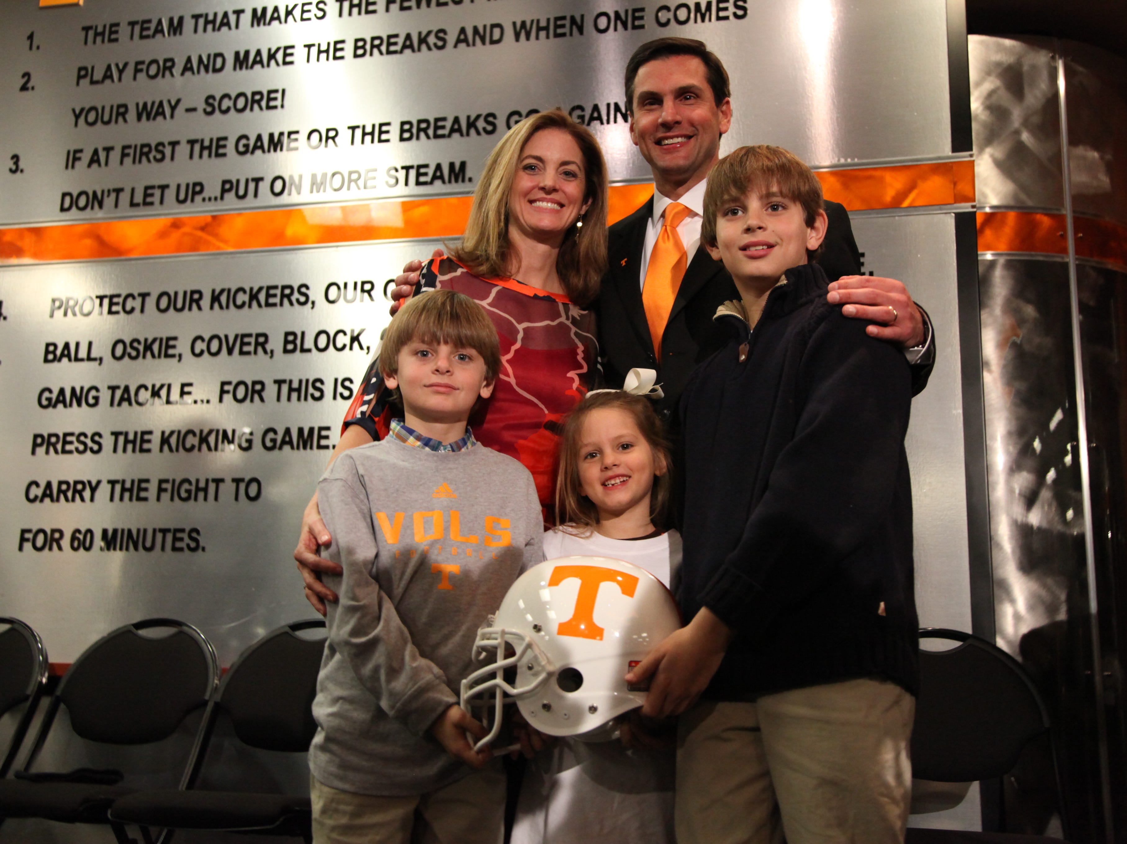 Tennessee head coach Derek Dooley poses with his wife Dr. Allison Jeffers Dooley and children, from left, Peyton, Juliana and John Taylor  press conference in the Peyton Manning Locker Room Complex at Neyland Stadium Friday, Jan. 15, 2010.