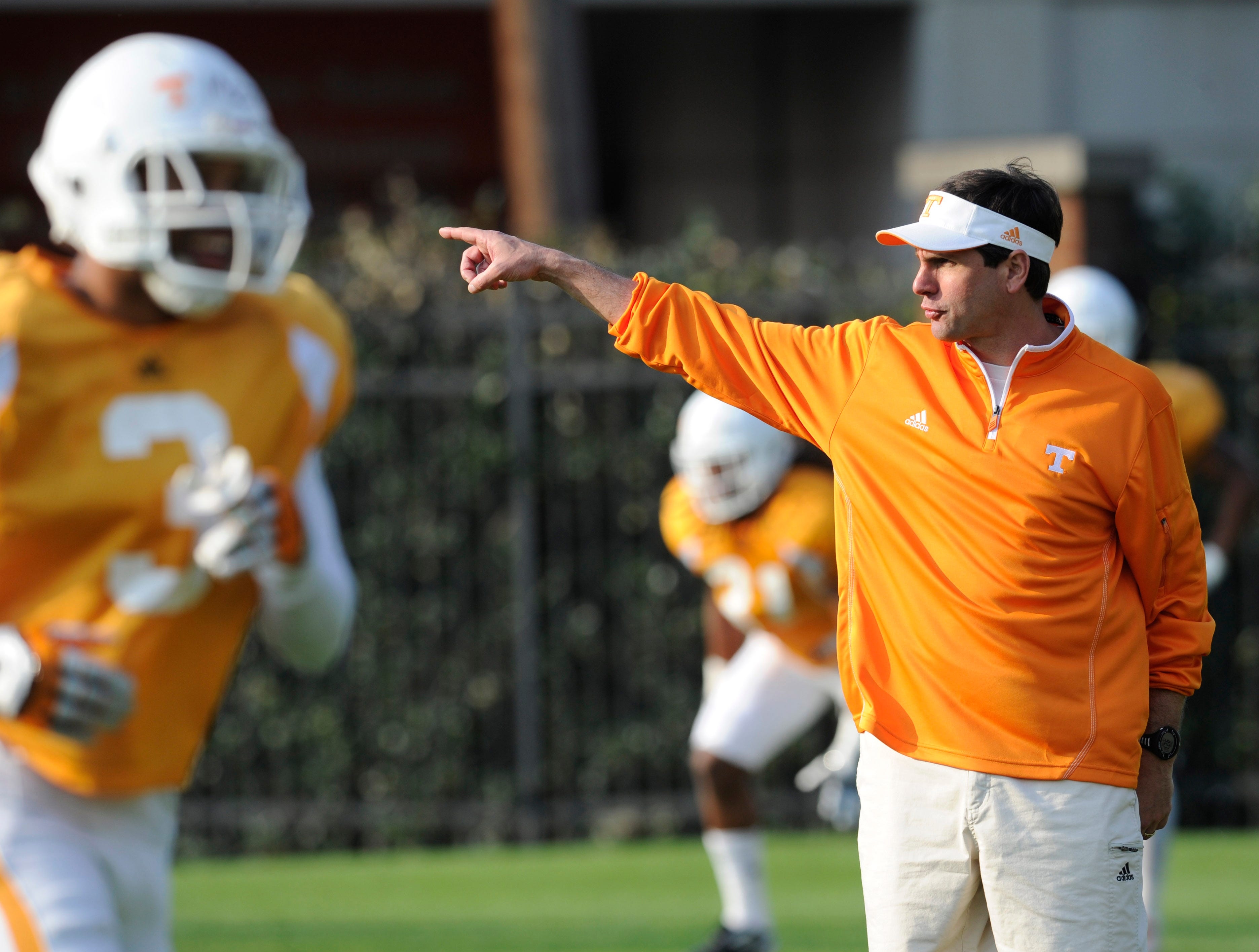 Head coach Derek Dooley directs players during spring practice at Haslam Field on Thursday, March 29, 2012.