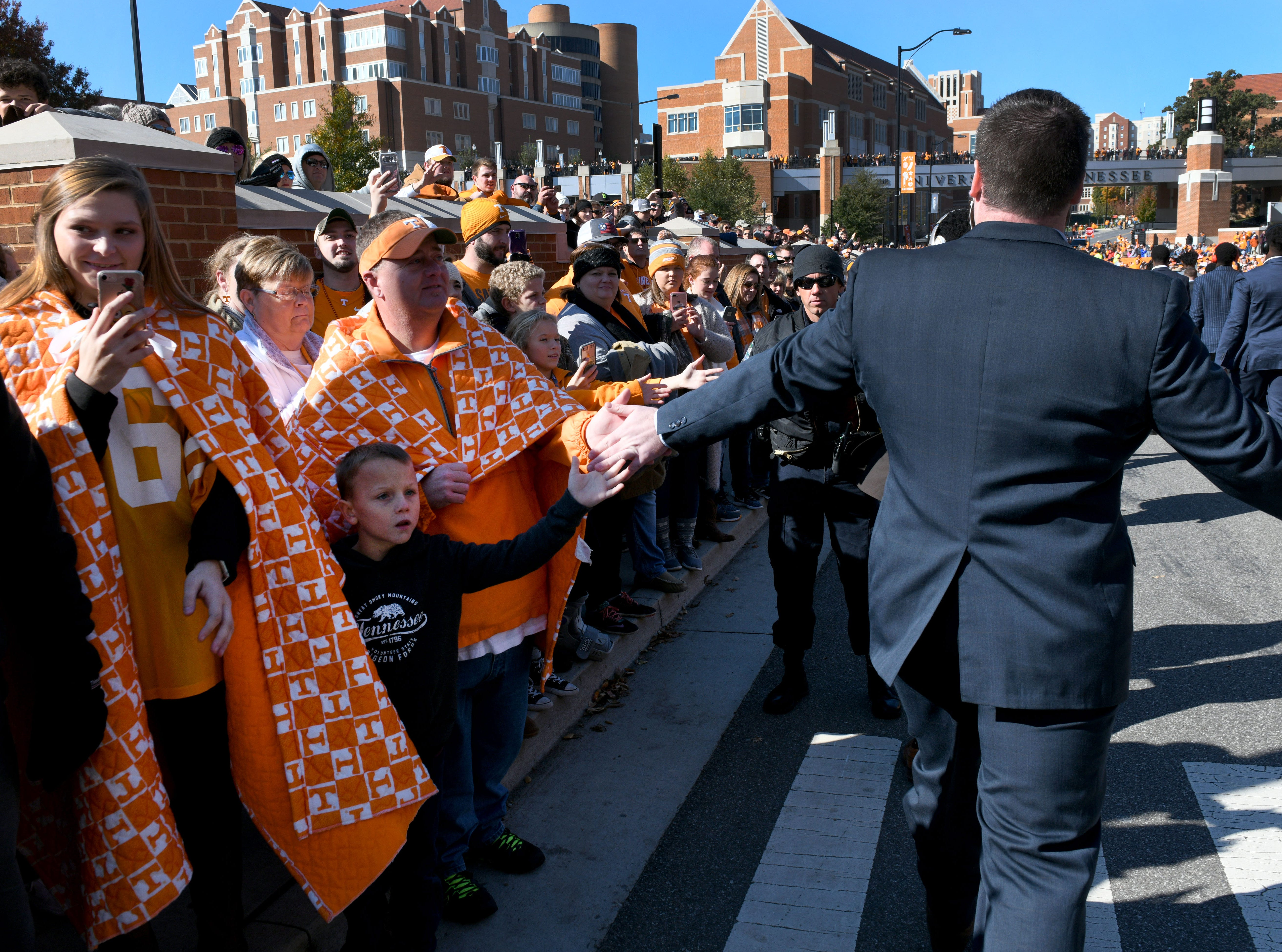 Bundled up Tennessee fans greet players during the Vol Walk before the Kentucky game Saturday, November 10, 2018 at Neyland Stadium in Knoxville, Tenn.