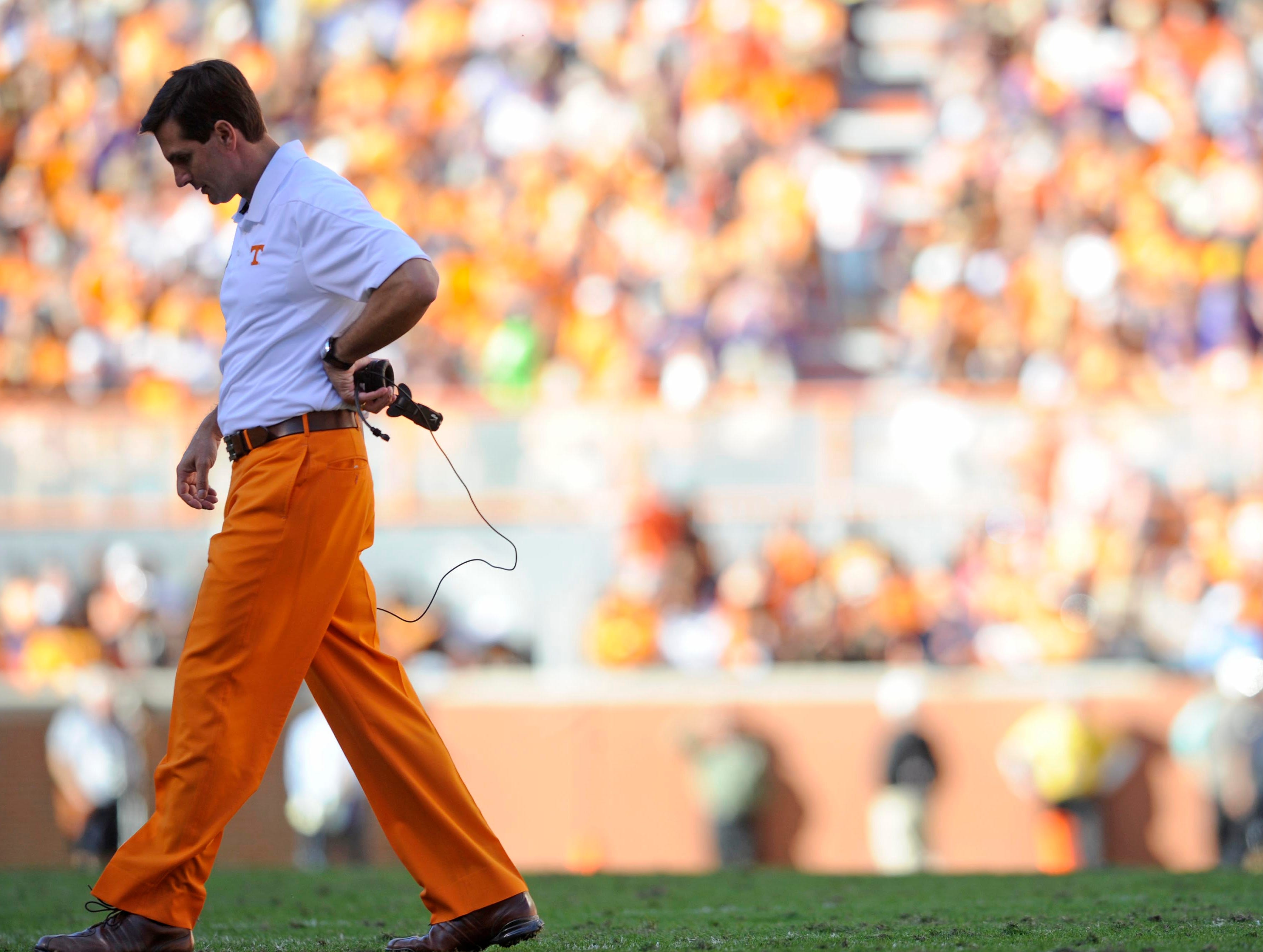 Tennessee head coach Derek Dooley walks to the sidelines during a timeout against LSU at Neyland Stadium on Saturday, Oct. 15, 2011.