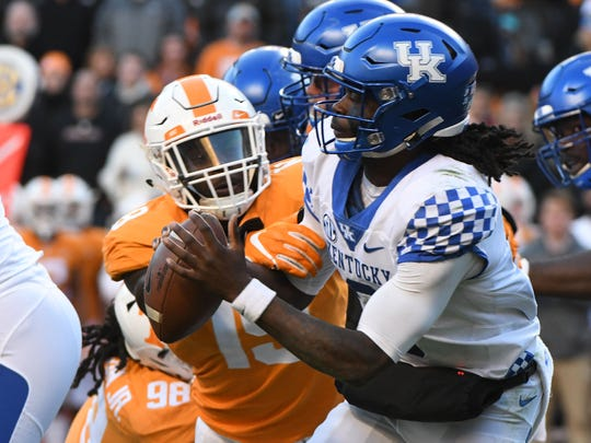 Kentucky quarterback Terry Wilson (3) is sacked by  Tennessee linebacker Darrell Taylor (19) during first half action in the Kentucky game Saturday, November 10, 2018 at Neyland Stadium in Knoxville, Tenn.