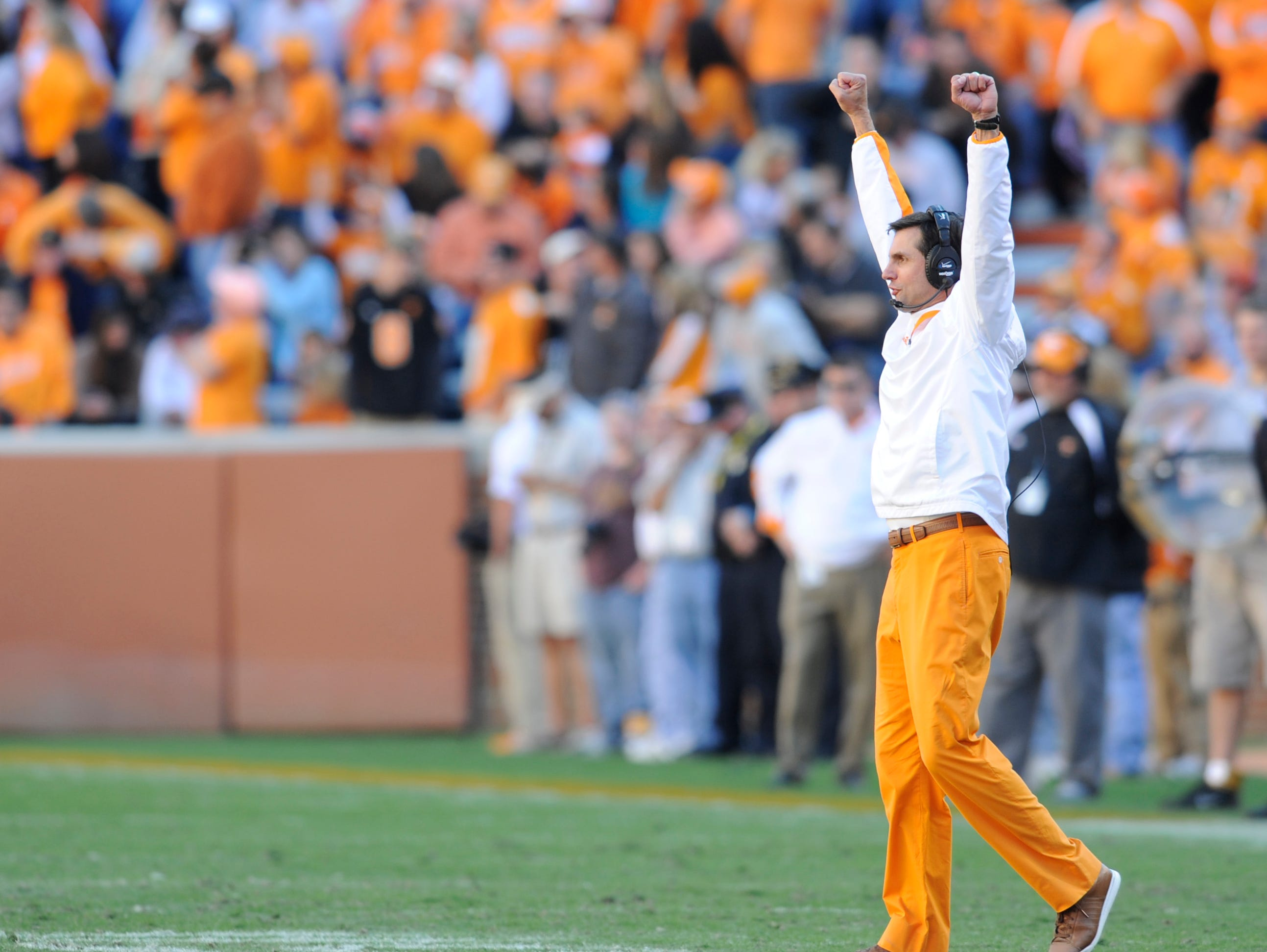 Tennessee head coach Derek Dooley celebrates a defensive stop during the second half against Missouri at Neyland Stadium Saturday, Nov. 10, 2012. UT lost in four overtimes 51-48.