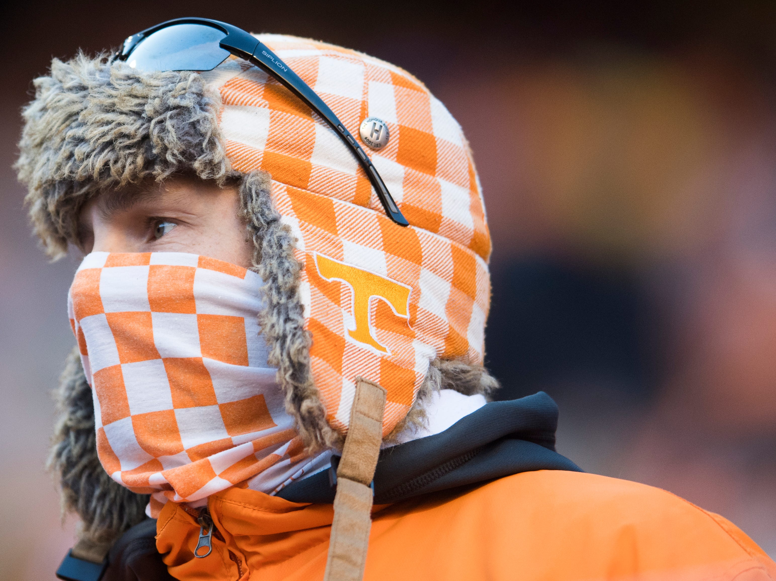 A Vol fan stays warm during a game between Tennessee and Kentucky at Neyland Stadium in Knoxville, Tennessee on Saturday, November 10, 2018.