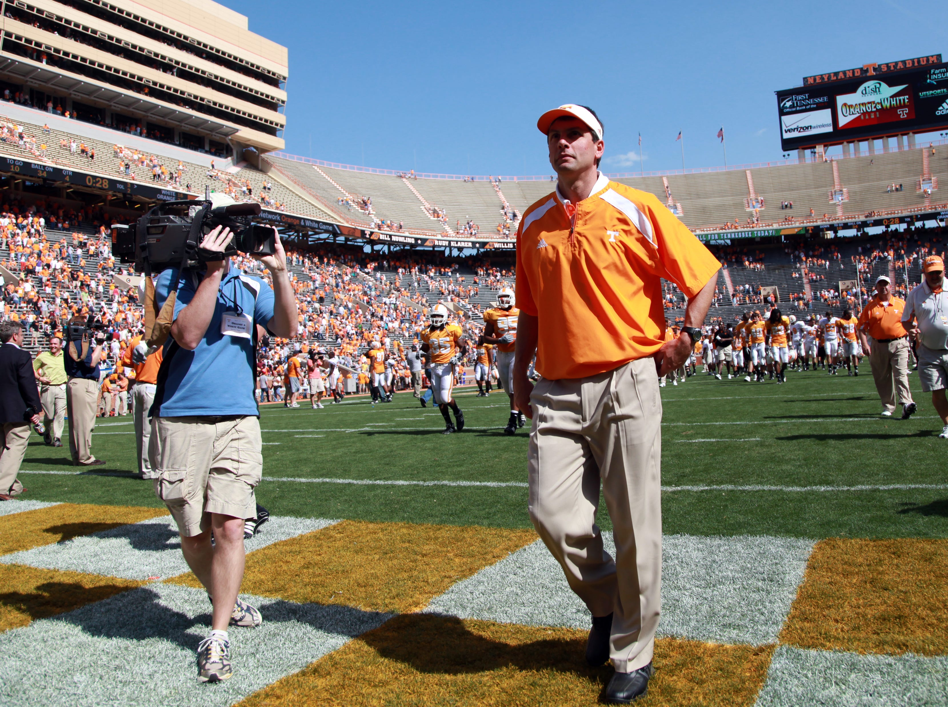 Tennessee head coach Derek Dooley leaves the field following the Orange and White game at Neyland Stadium Saturday, Apr. 17, 2010.