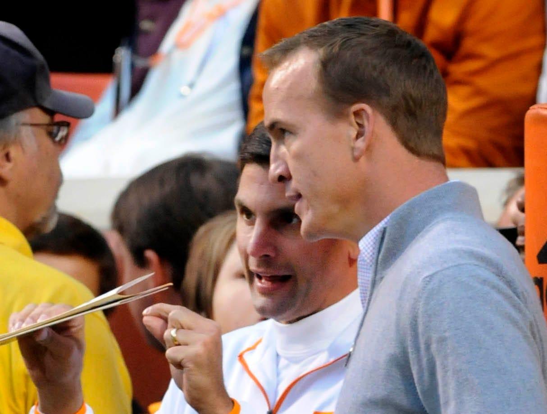 Peyton Manning talking to Derek Dooley during team warm-ups before their game against Alabama Saturday at Neyland Stadium.