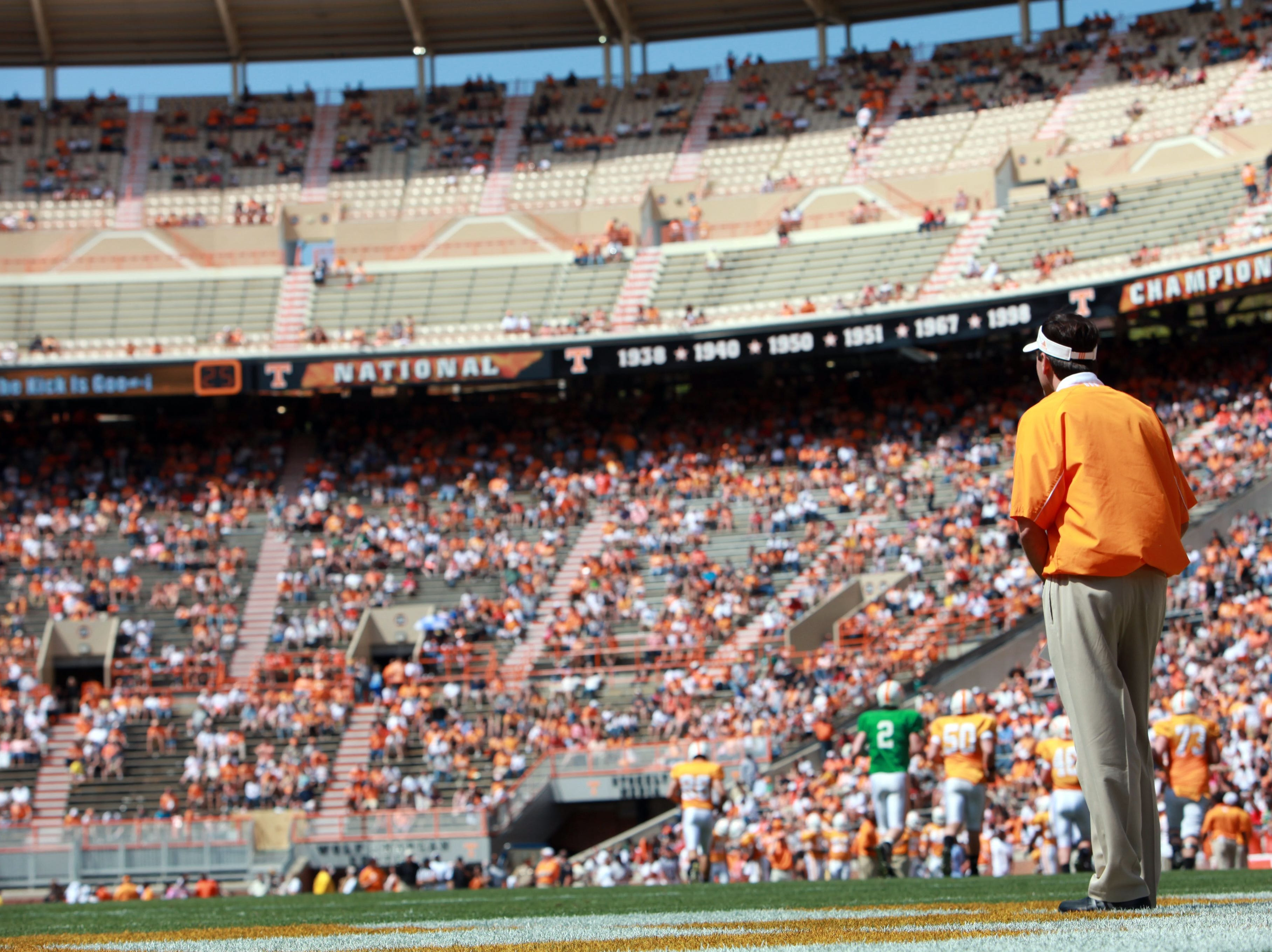 In this photo taken on Saturday, April 17, 2010, Tennessee head coach Derek Dooley looks on after a field goal during the Orange and White spring college football game at Neyland Stadium in Knoxville, Tenn.