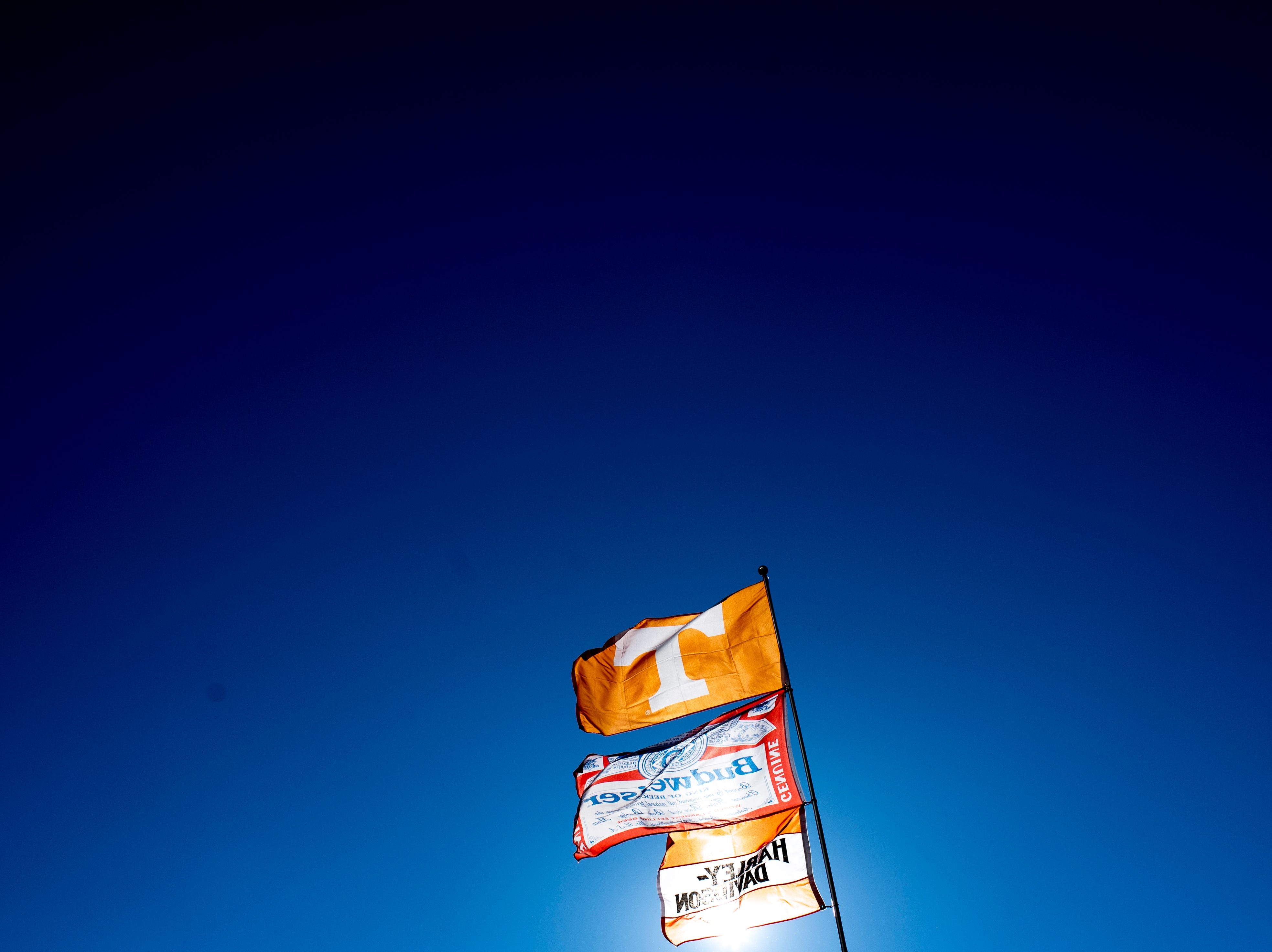 A Tennessee flag flies above the tailgates during a game between Tennessee and Kentucky at Neyland Stadium in Knoxville, Tennessee on Saturday, November 10, 2018.