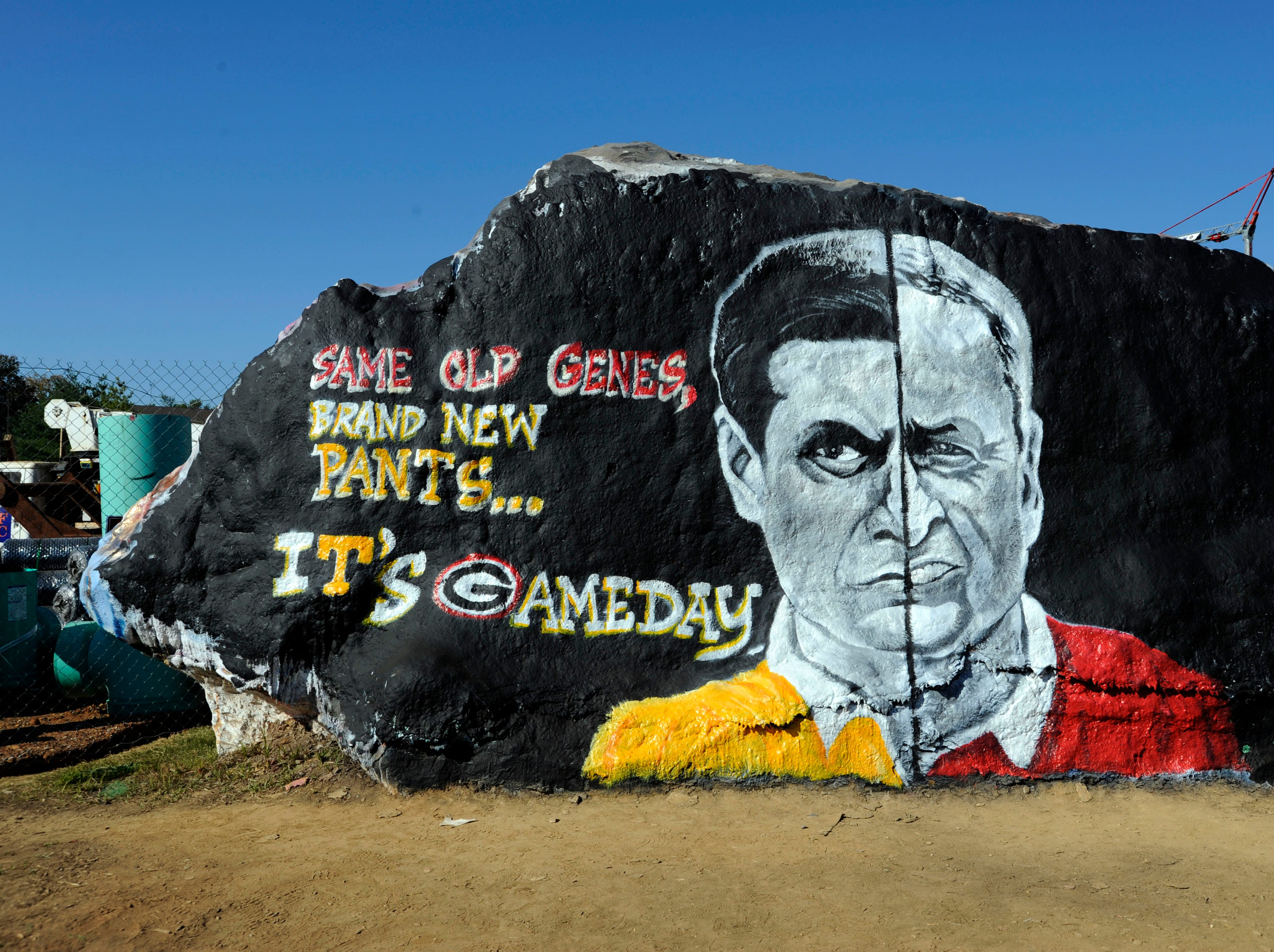 Artists painted the rock on the University of Tennessee campus with half-faces of UT coach Derek Dooley and his father Vince Dooley, former Georgia coach before the game Saturday, Oct. 8, 2011.