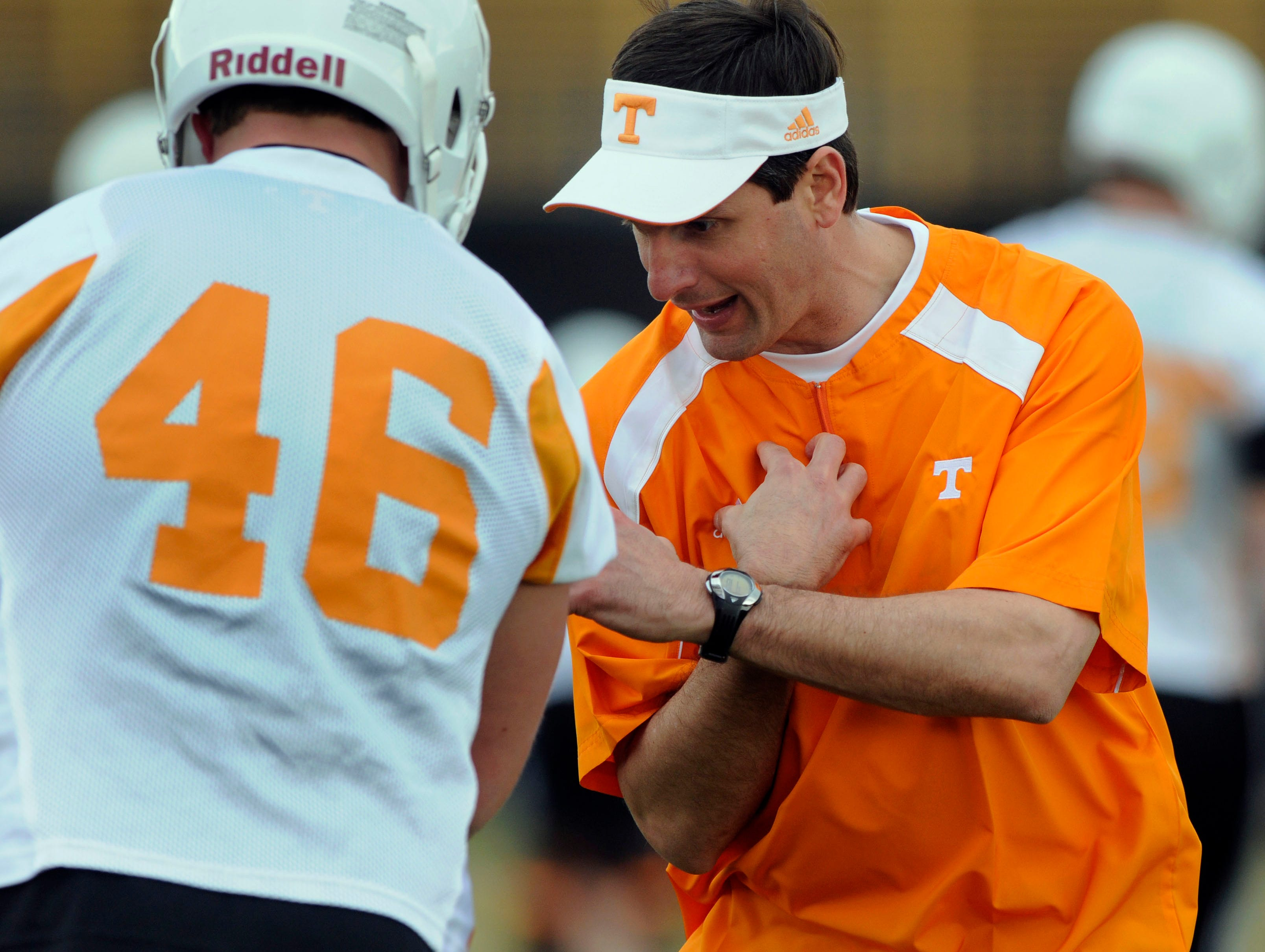 UT head coach Derek Dooley works with Channing Fugate during the first day of UT spring football practice Thursday, Mar. 18, 2010 at Haslam Field on campus.