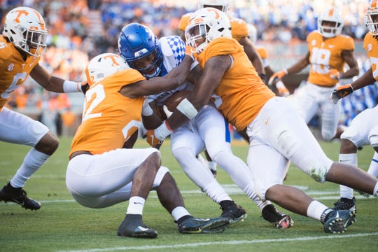 Kentucky wide receiver Lynn Bowden Jr. (1) is taken down by Tennessee defensive back Micah Abernathy (22) and Tennessee defensive lineman Kyle Phillips (5) during a game between Tennessee and Kentucky at Neyland Stadium in Knoxville, Tennessee on Saturday, November 10, 2018.