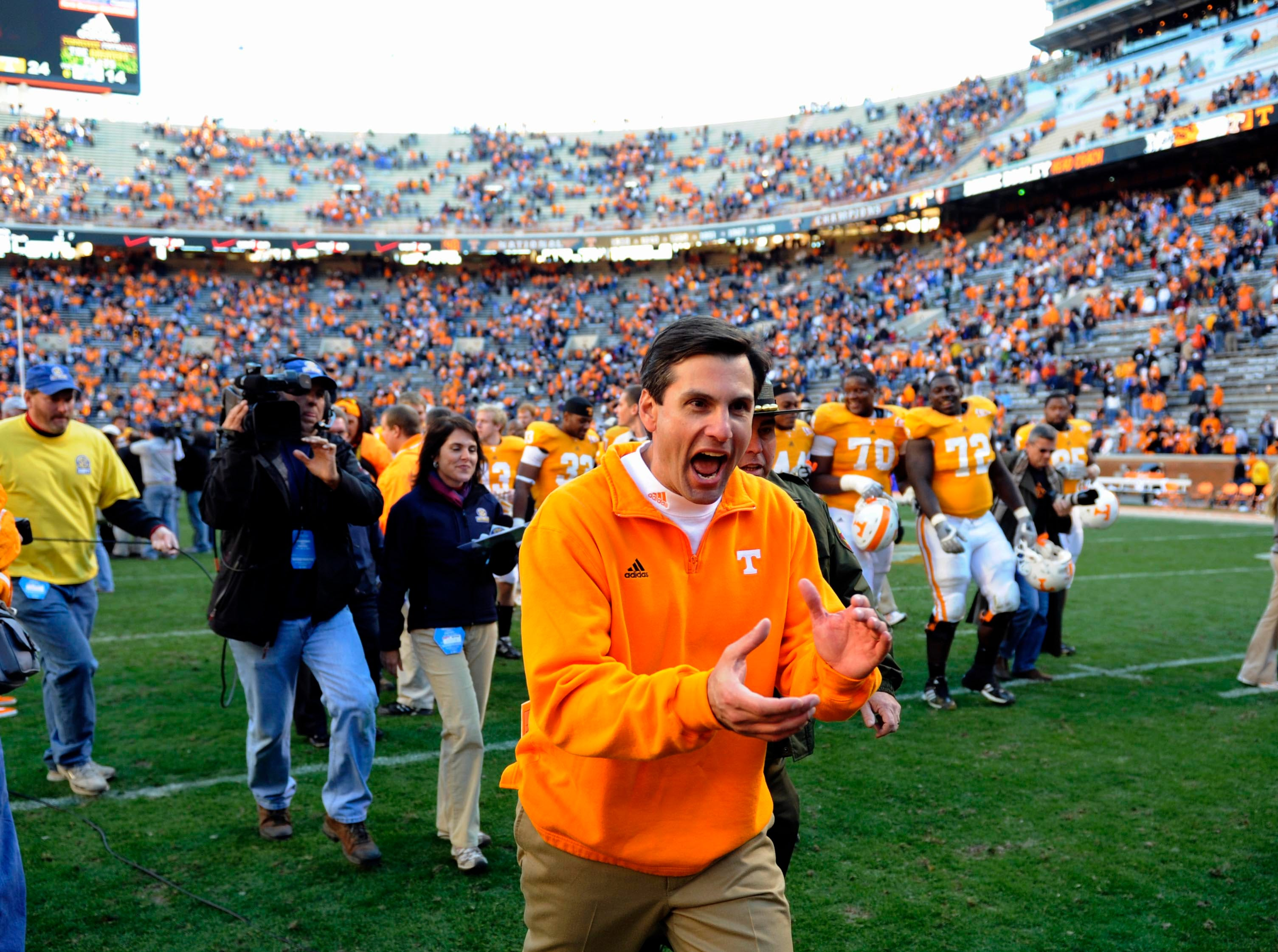Tennessee head coach Derek Dooley celebrates as he leaves the field Saturday, Nov. 27, 2010 after beating Kentucky in Neyland Stadium in Knoxville. Tennessee won 24-14.