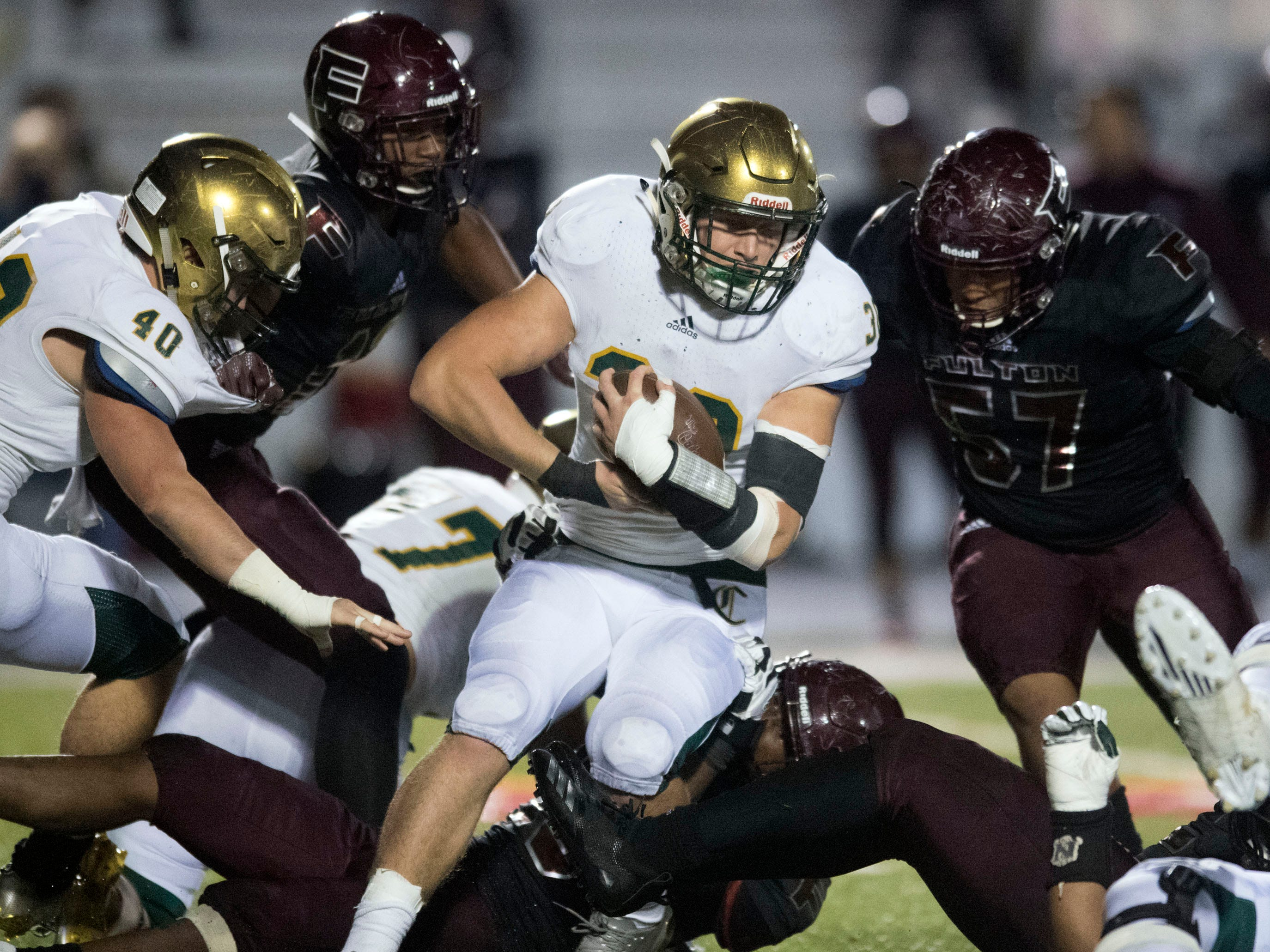 Knoxville Catholic's Cody Duncan (30) on a run against Fulton. Knoxville Catholic beat Fulton, 28-25 in the second round of the Class 5A playoffs on Friday, November 9, 2018.