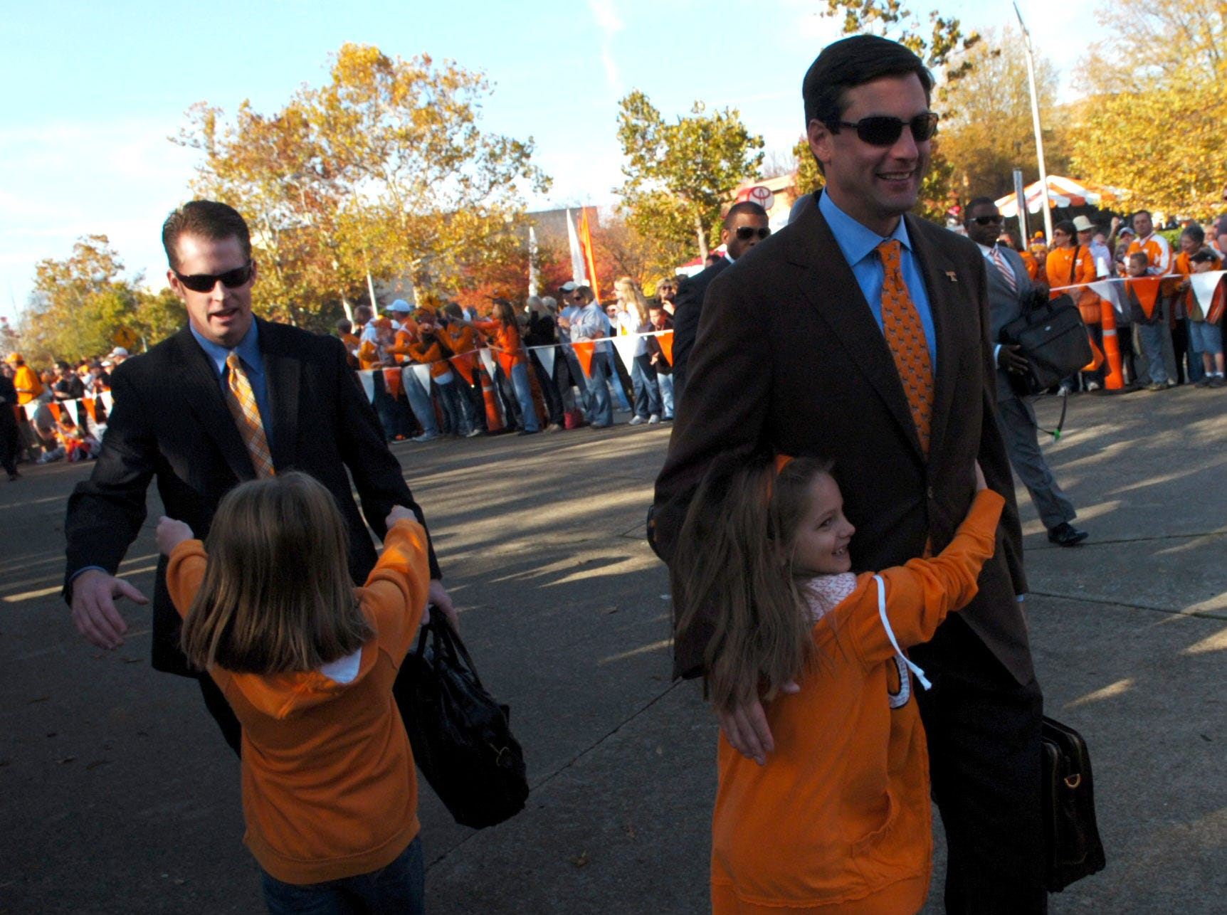 Tennessee quarterbacks coach Darin Hinshaw and head coach Derek Dooley are greeted by daughters Carley and Julianna before the Vol Walk on Saturday, Nov. 13, 2010.