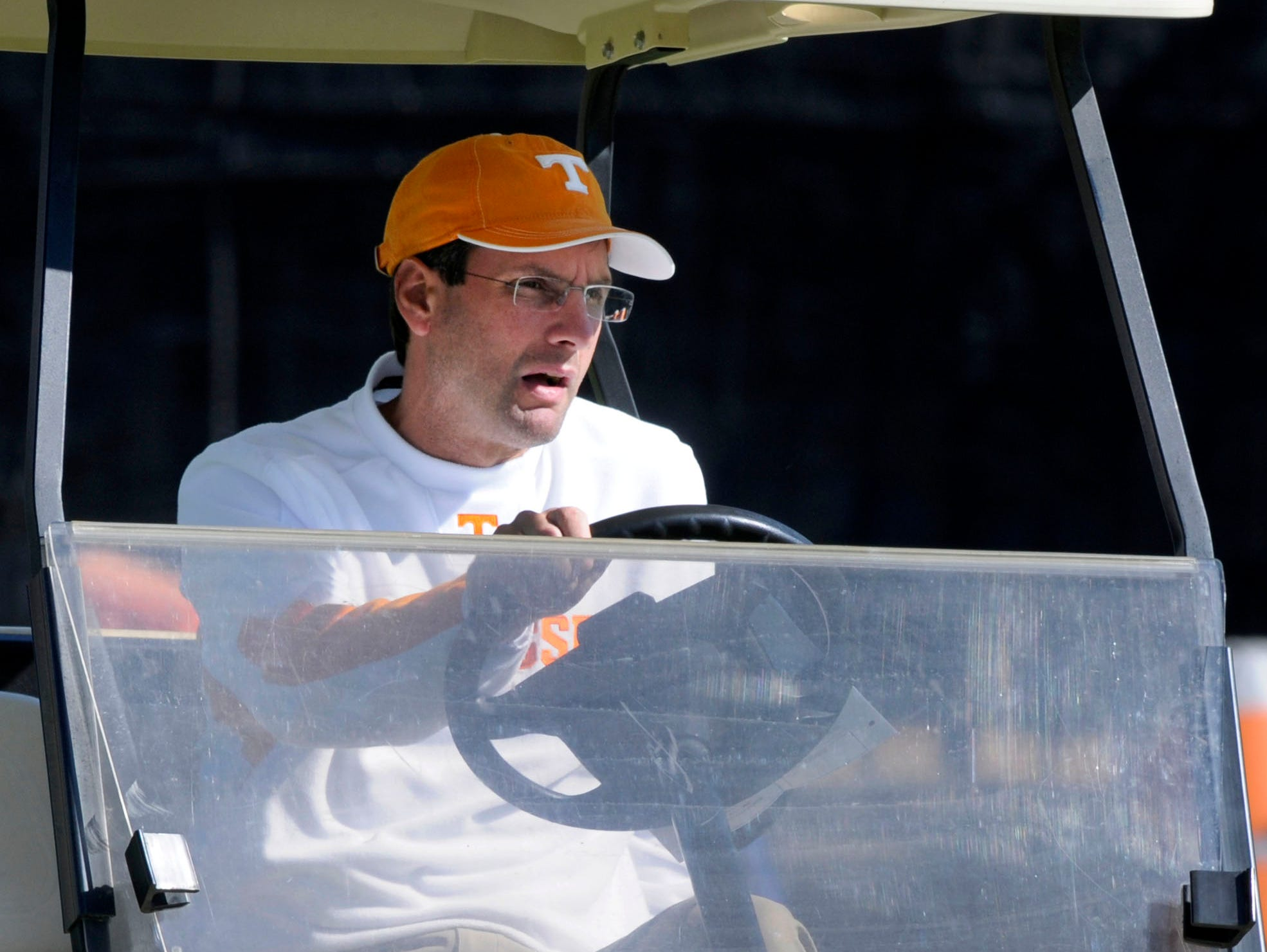 Tennessee Volunteers head coach Derek Dooley arrived for practice Thursday, Oct. 11, 2012 in a golf cart with his crutches riding in the back.