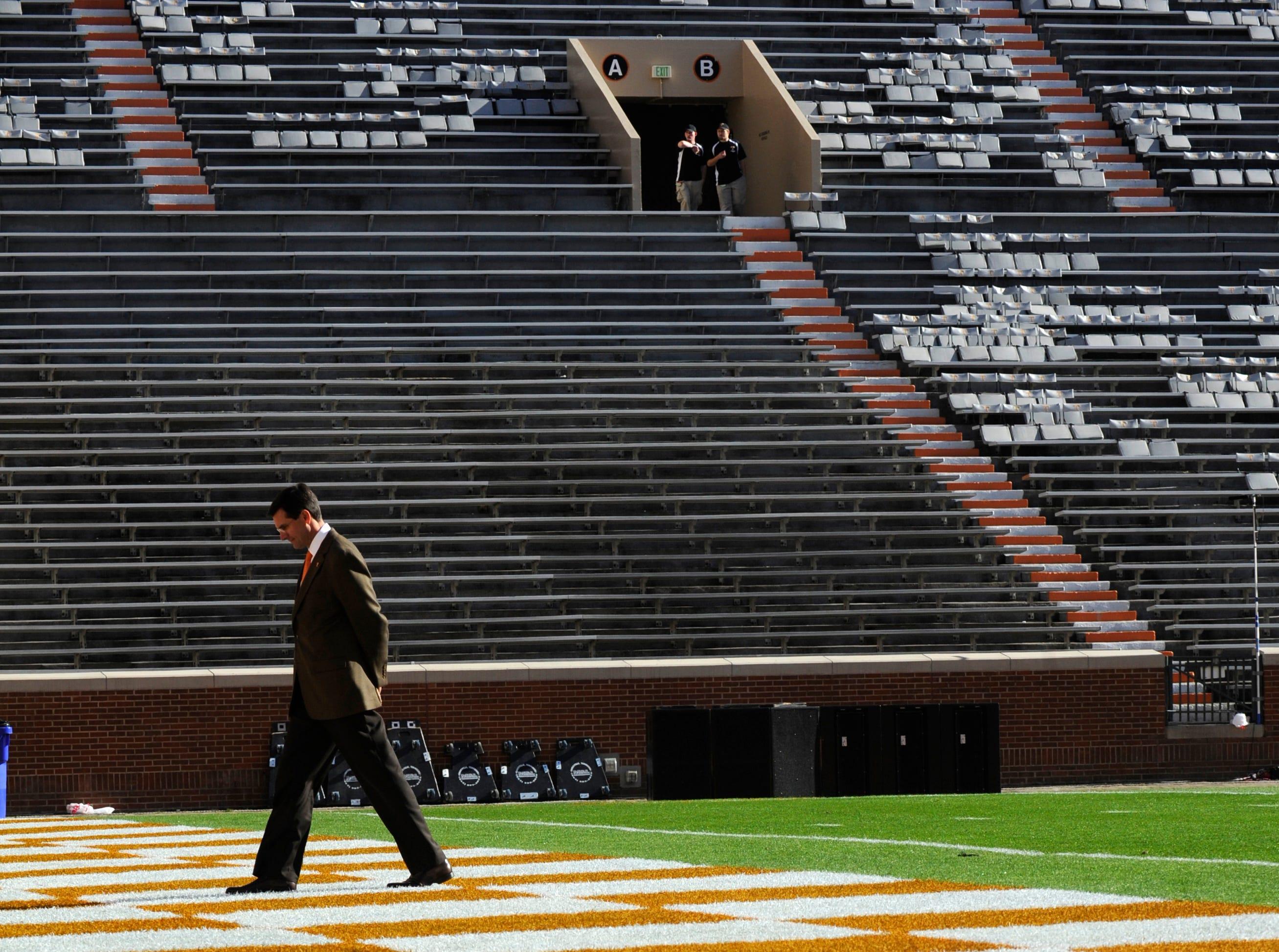 Tennessee head football coach Derek Dooley surveys the field before the game against Missouri at Neyland Stadium, Saturday, Nov. 10, 2012.