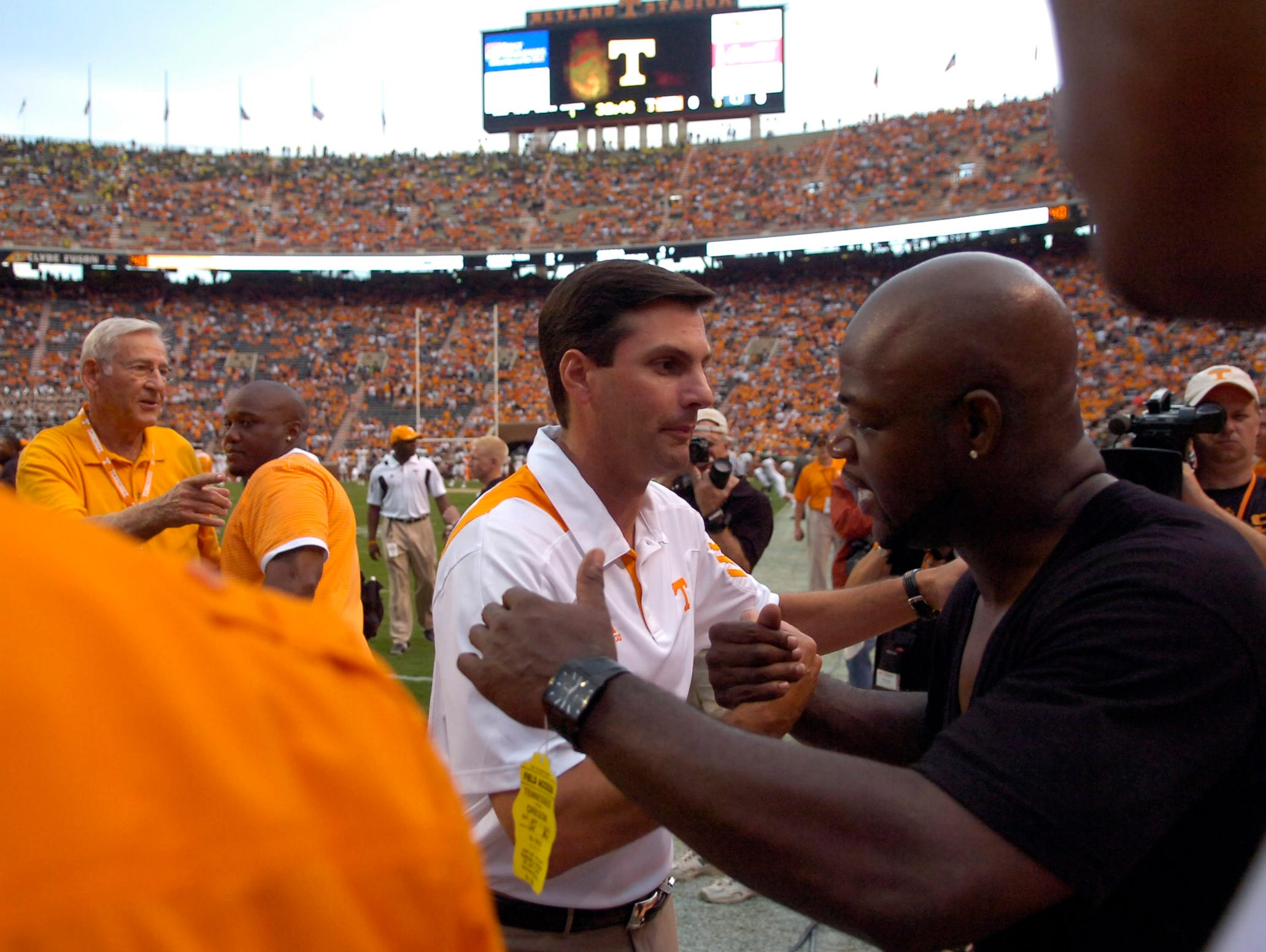 Tennessee head coach Derek Dooley greets former player Al Wilson before the game against Oregon at Neyland Stadium on Saturday, Sept. 11, 2010.