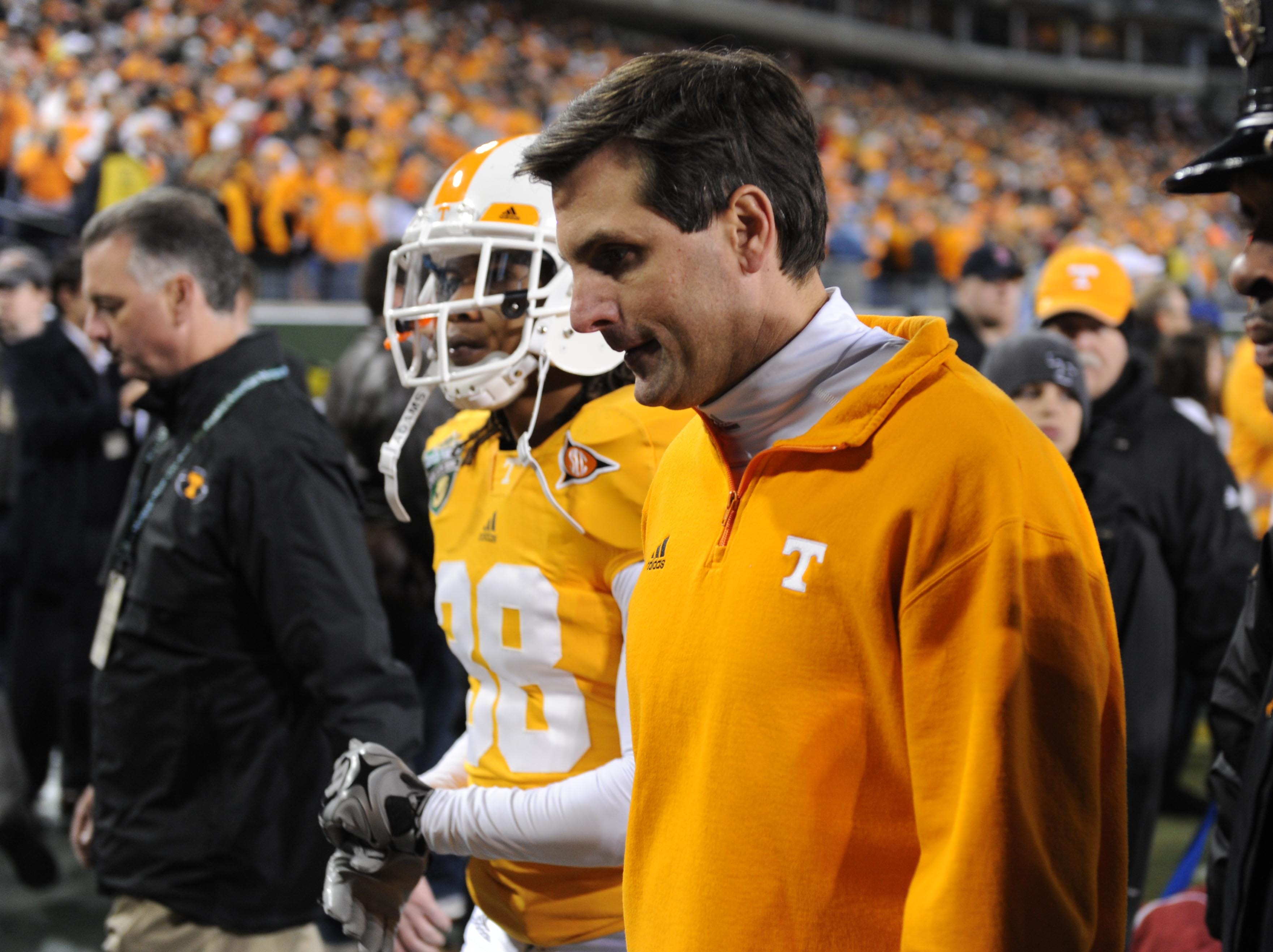 Tennessee head coach Derek Dooley leaves the field after their 30-27 loss in double overtime to North Carolina Thursday, Dec. 30, 2010 in the Music City Bowl in Nashville at LP Field.