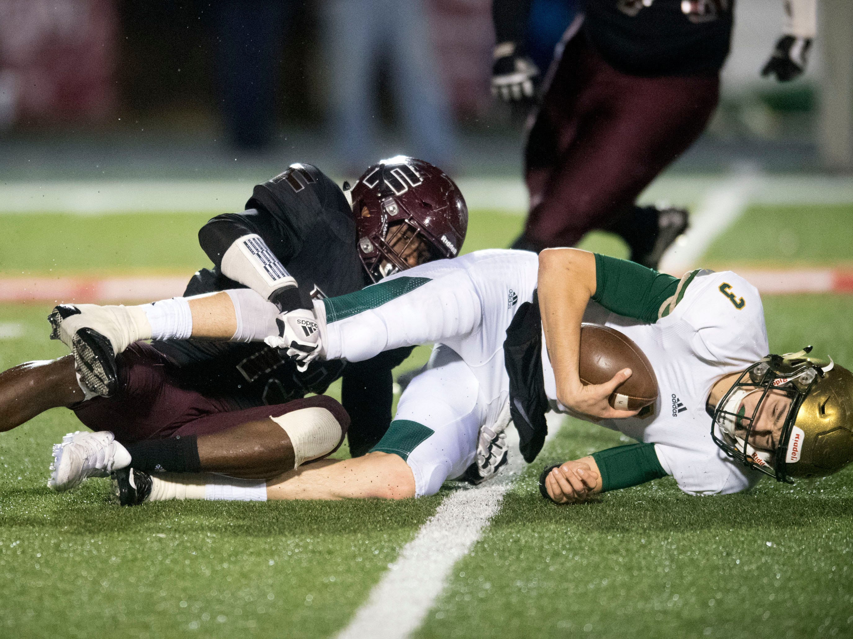 Knoxville Catholic's Jack Jancek (3) is sacked by Fulton's Elijah Davis (19). Knoxville Catholic beat Fulton, 28-25 in the second round of the Class 5A playoffs on Friday, November 9, 2018.