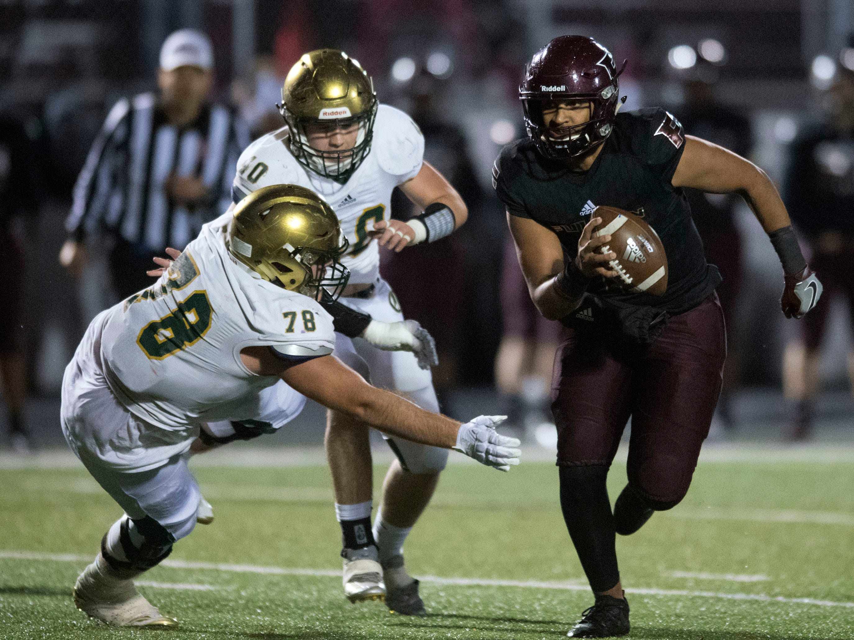 Fulton's Xavier Malone (1) runs the ball while pursued by Knoxville Catholic's Chris Torres (40) and Cooper Mays (78). Knoxville Catholic beat Fulton, 28-25 in the second round of the Class 5A playoffs on Friday, November 9, 2018.
