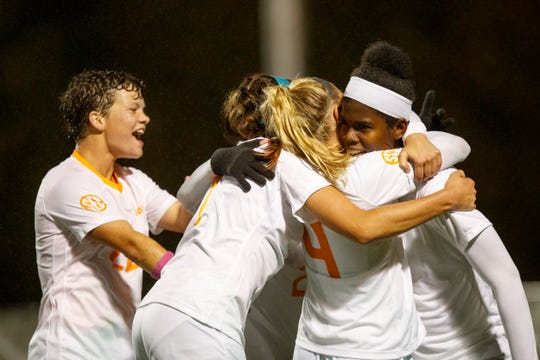 Members of the Tennessee soccer team congratulate Bunny Shaw after scoring the game-winning goal against Louisville in the first round of the NCAA women's soccer tournament at Regal Soccer Stadium on Nov. 9, 2018.