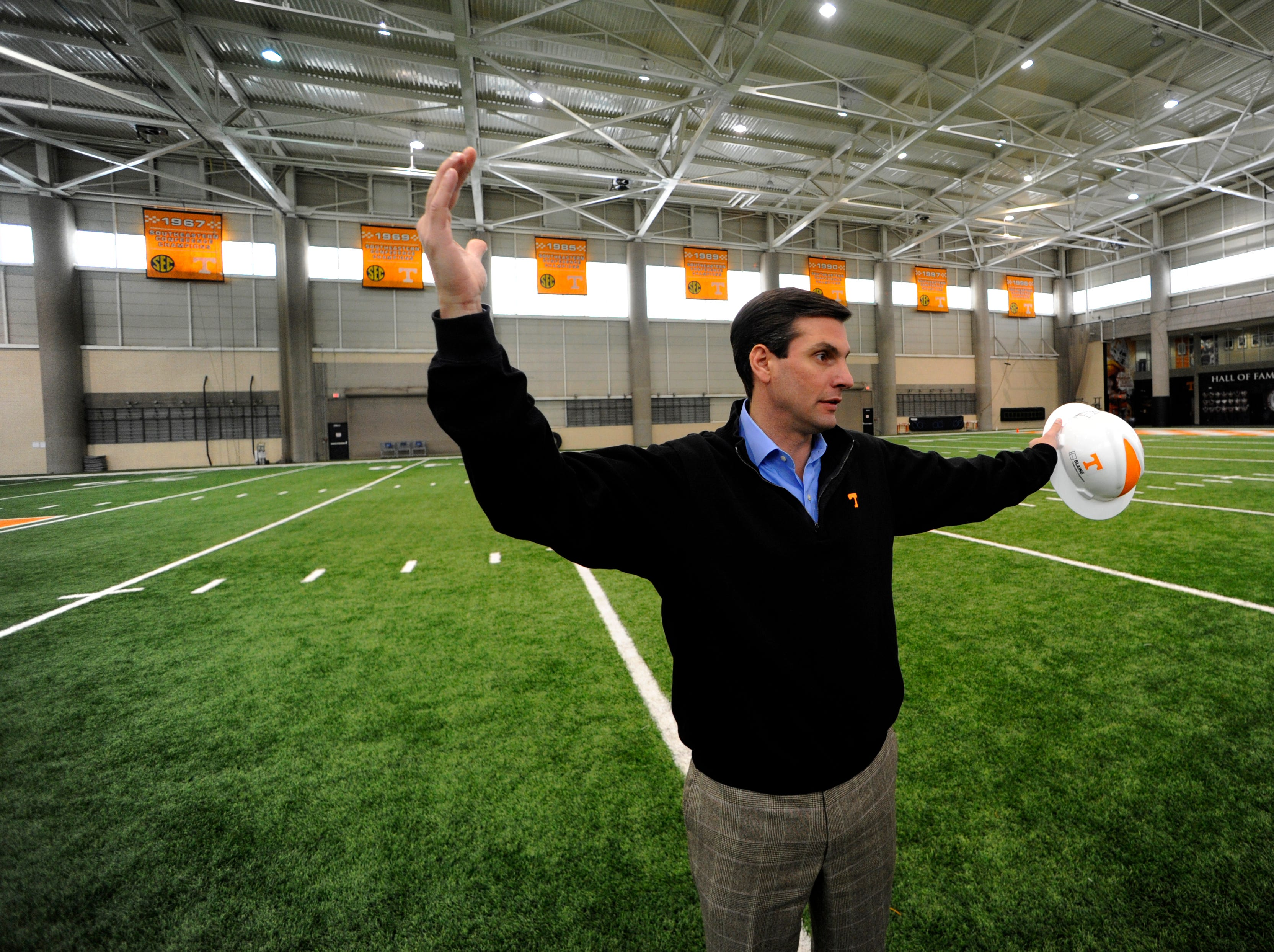 Tennessee head football coach Derek Dooley gave the News Sentinel a tour of the new football training facility Thursday, Feb. 9, 2012. Dooley started the tour in the current indoor facility which opened in 1989. The new facility is connected to the south end of the current facility and when opened and occupied by football the north and east sides will be renovated to accommodate others sports programs currently housed in the Stokley Athletic Center.