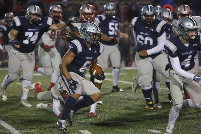 Farragut's Isaiah Gibbs maneuvers through a crowd of players during the Farragut versus Ooltewah TSSAA play-off high school football game at Farragut high school in Knoxville Friday Nov. 9 2018.