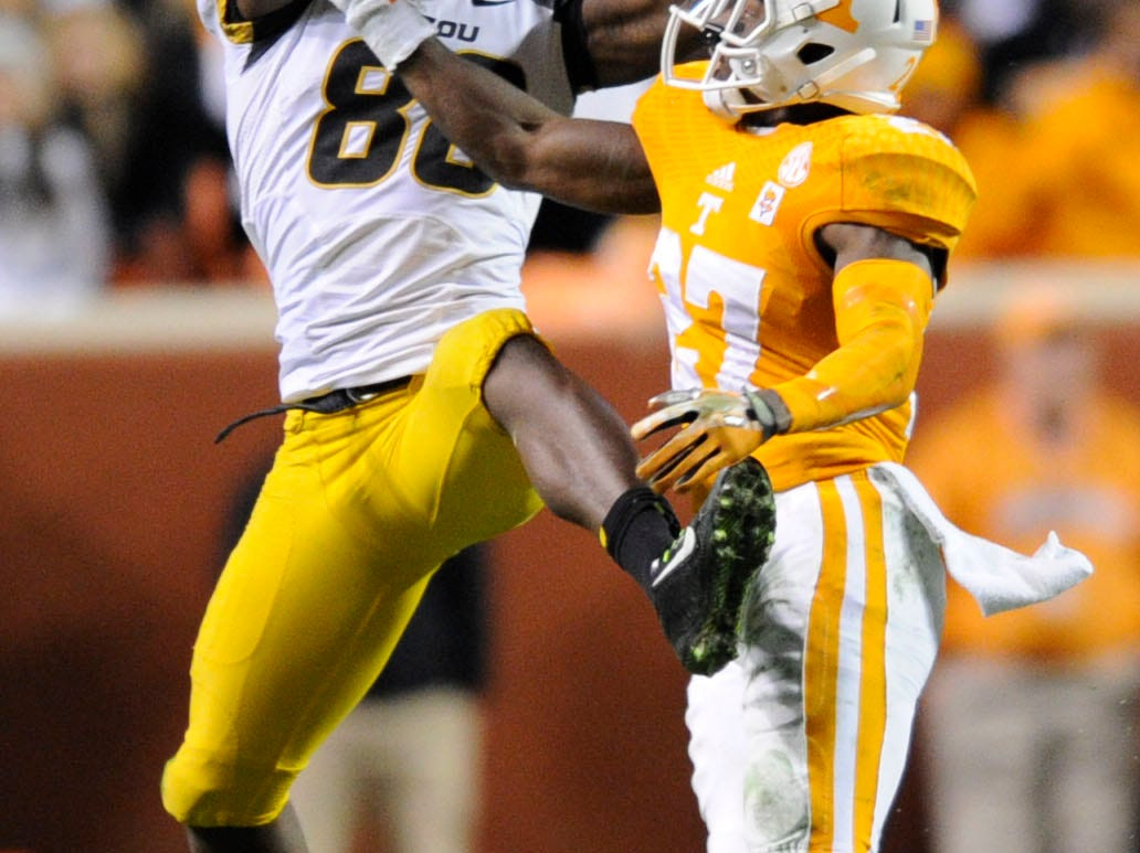 Missouri wide receiver Jimmie Hunt (88) makes a 73 yard catch and runs for a touchdown with Tennessee defensive back Justin Coleman (27) defending and during their college football game at Neyland Stadium, Saturday, Nov. 22, 2014 in Knoxville, TN. Tennessee lost the game 29-21.