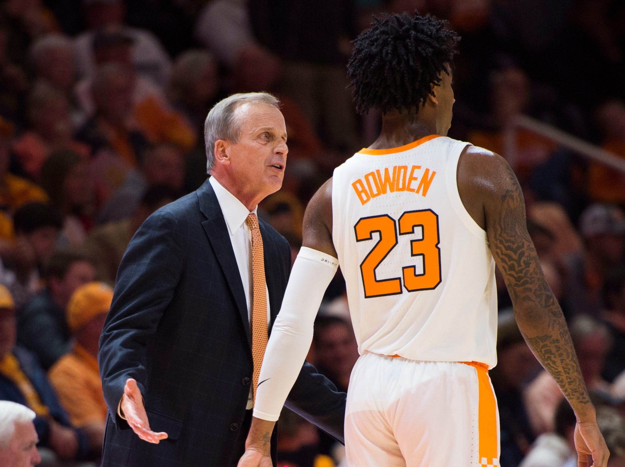 Tennessee head coach Rick Barnes speaks to Tennessee's Jordan Bowden (23) on the sidelines during a game between Tennessee and Louisiana in Thompson-Boling Arena Friday, Nov. 9, 2018. Tennessee defeated Louisiana 87-65.