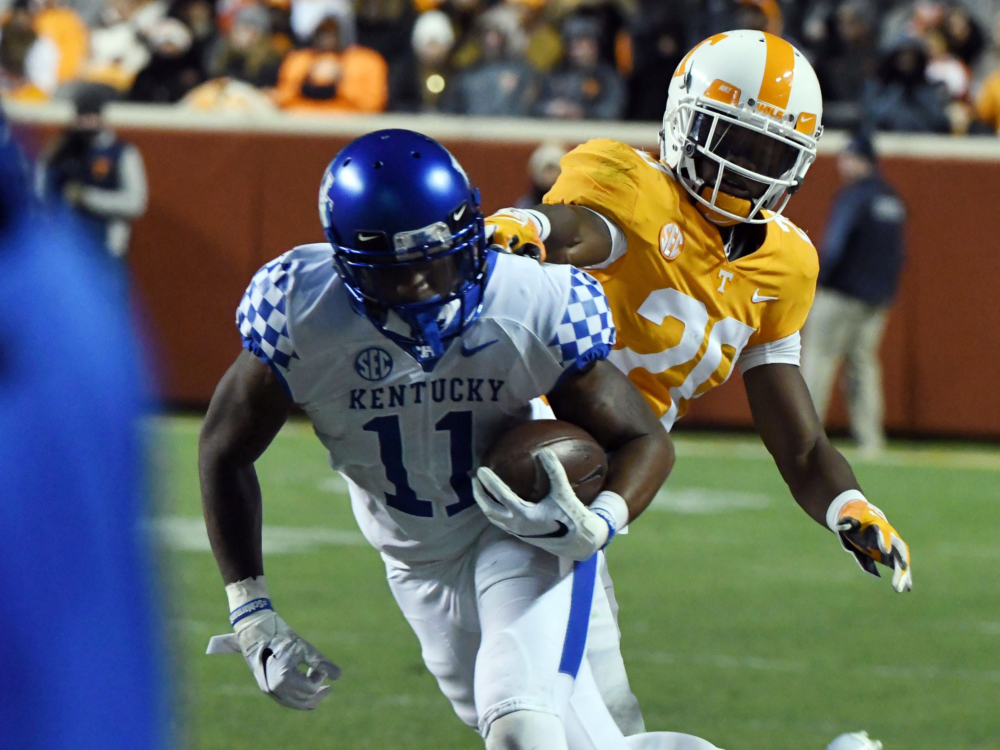 Tennessee defensive back Bryce Thompson (20) gets his hand on Kentucky wide receiver Tavin Richardson (11)  during first half action in the Kentucky game Saturday, November 10, 2018 at Neyland Stadium in Knoxville, Tenn.