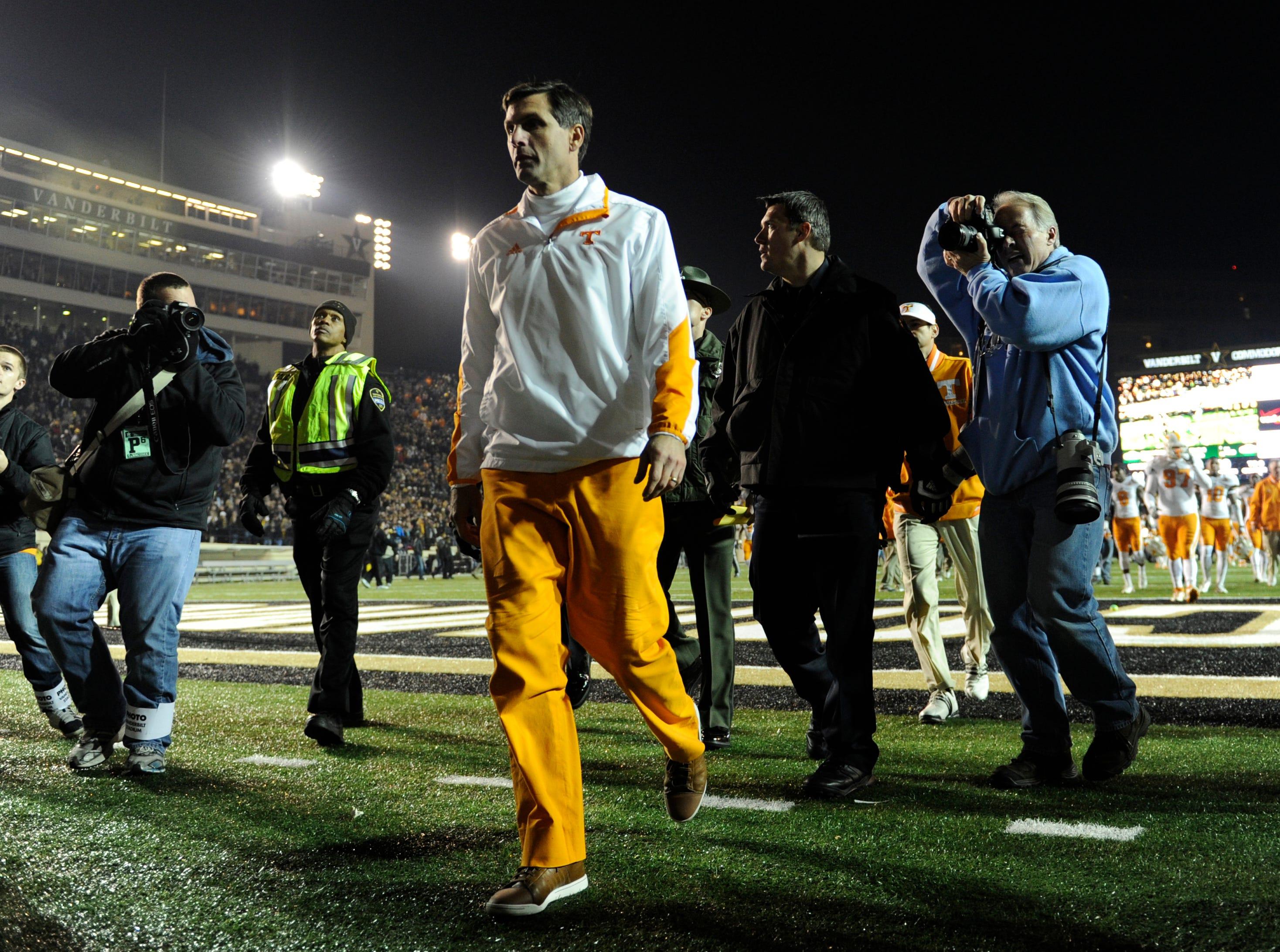 Tennessee head coach Derek Dooley leaves the field after the loss to Vanderbilt at Vanderbilt Stadium in Nashville on Saturday, Nov. 17, 2012. Vanderbilt defeated Tennessee 41-18.