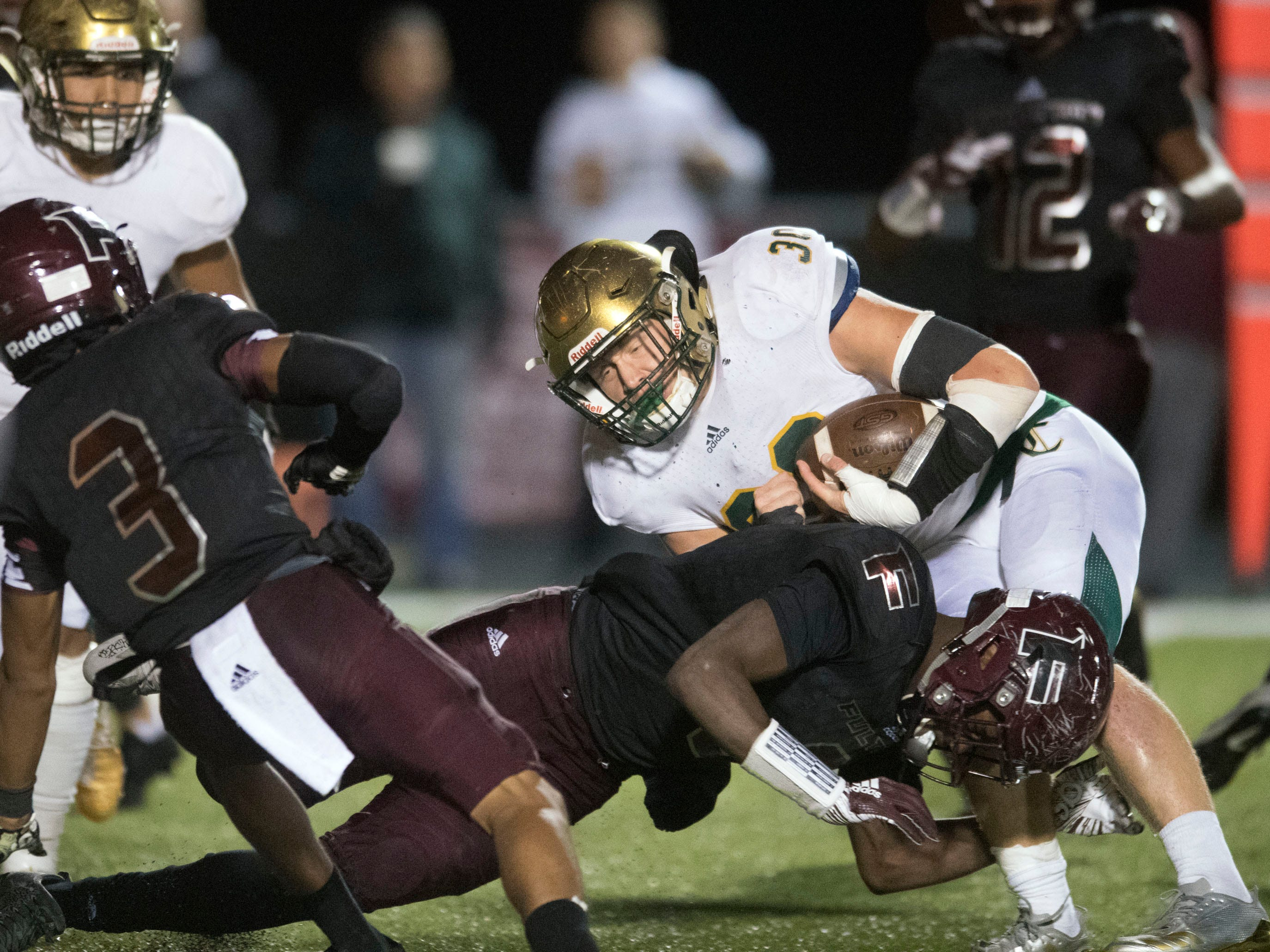 Knoxville Catholic's Cody Duncan (30) on a run play against Fulton. Knoxville Catholic beat Fulton, 28-25 in the second round of the Class 5A playoffs on Friday, November 9, 2018.
