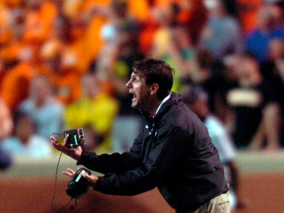 Tennessee head coach Derek Dooley talks to referees during the game against Oregon at Neyland Stadium on Saturday, Sept. 11, 2010.