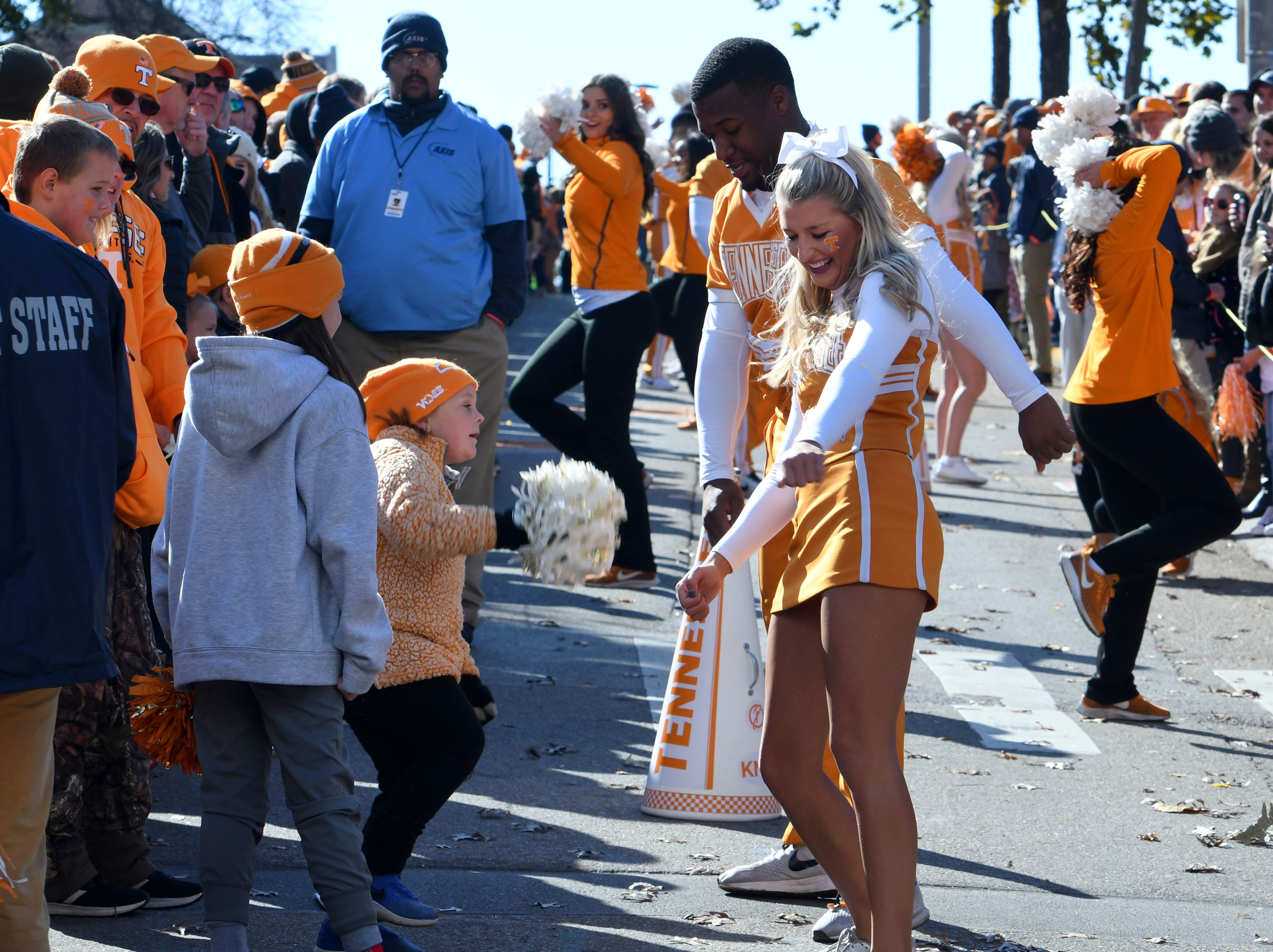 Tennessee cheerleaders dancing with fans during the Vol Walk before the Kentucky game Saturday, November 10, 2018 at Neyland Stadium in Knoxville, Tenn.