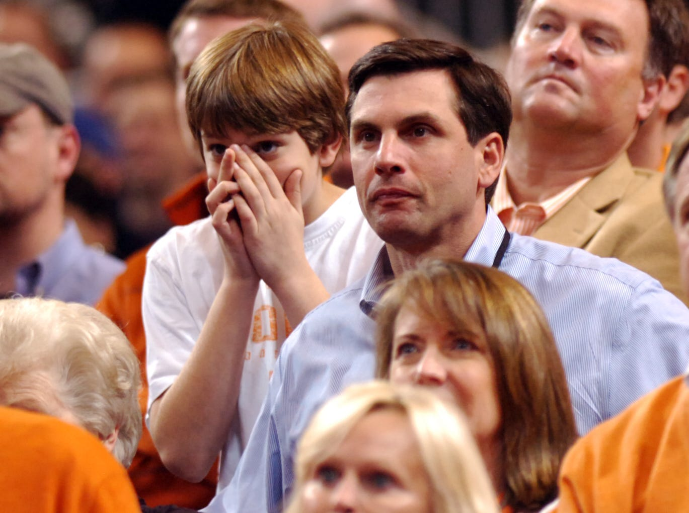 Tennessee football head coach Derek Dooley, right, and son John Taylor, left, watch the Vols take on the Michigan State Spartans during the final seconds of the NCAA tournament at the Edward Jones Dome in St. Louis, Mo., Sunday, Mar. 28, 2010.