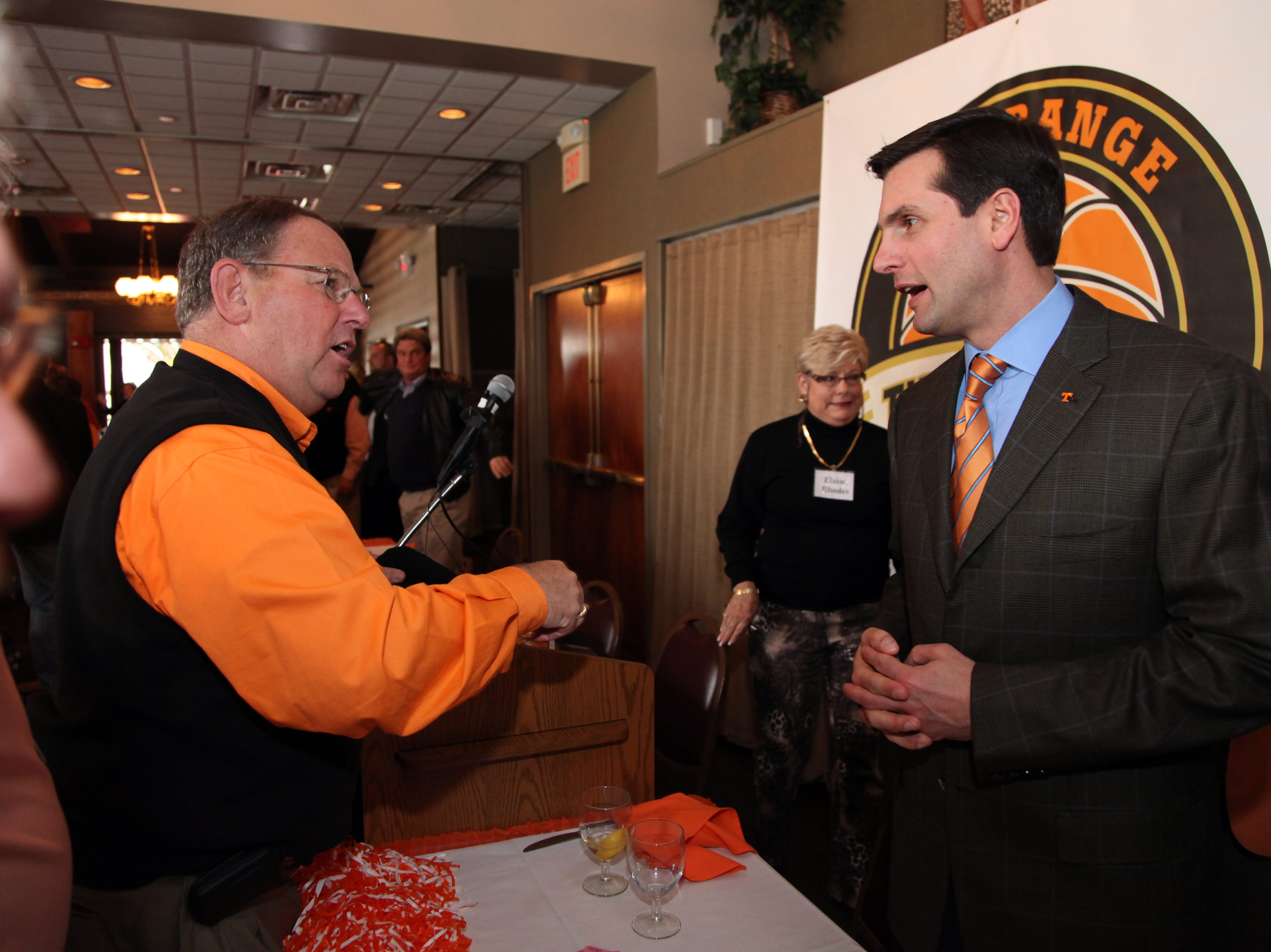 Steve West, left, talks with Tennessee football coach Derek Dooley after Dooley's speech at the Big Orange Tip-off Club Wednesday, Feb. 24, 2010 at Calhoun's on the River.