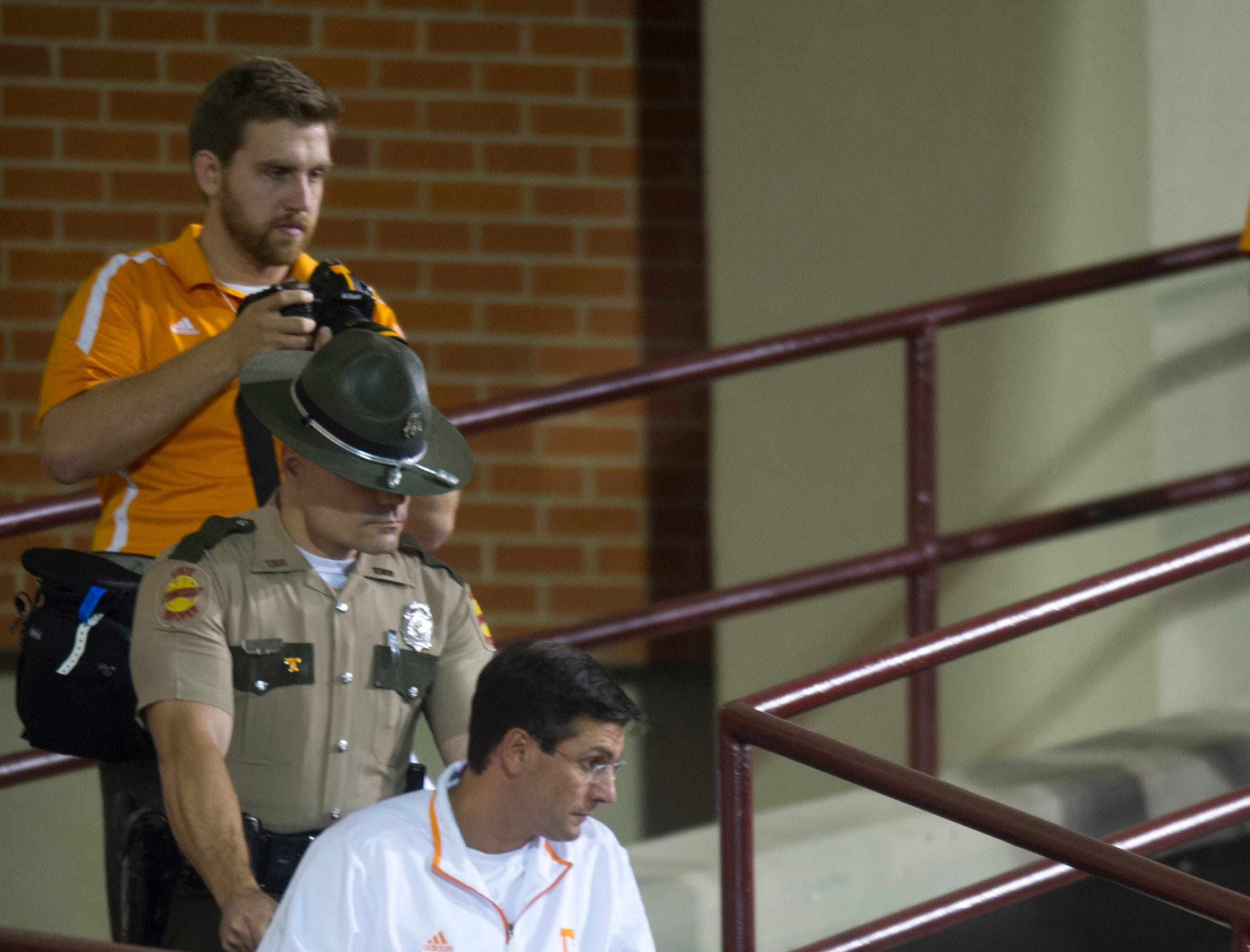 Tennessee head coach Derek Dooley is wheeled down a ramp from the locker room before the game against Mississippi State at Davis Wade Stadium in Starkville, Miss., Saturday, Oct. 13, 2012. Dooley underwent hip surgery earlier this week and is coaching the game from the press box.