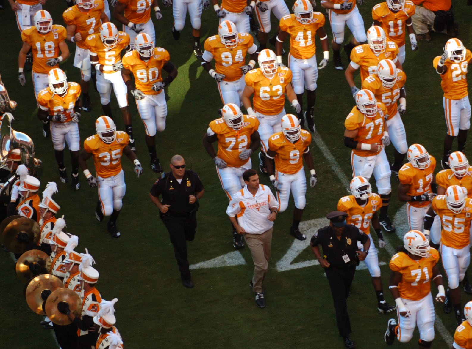 "Tennessee coach Derek Dooley runs through the ""T"" for the first time as the Vols open the Dooley era against UT Martin Saturday, Sept. 4, 2010 at Neyland Stadium. The Vols' season opener was a 50 - 0 victory in Derek Dooley's debut as head coach."